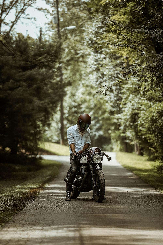 man riding motorcycle on pathway