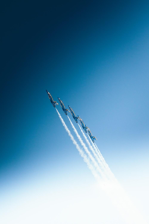 five jet flying in sky
