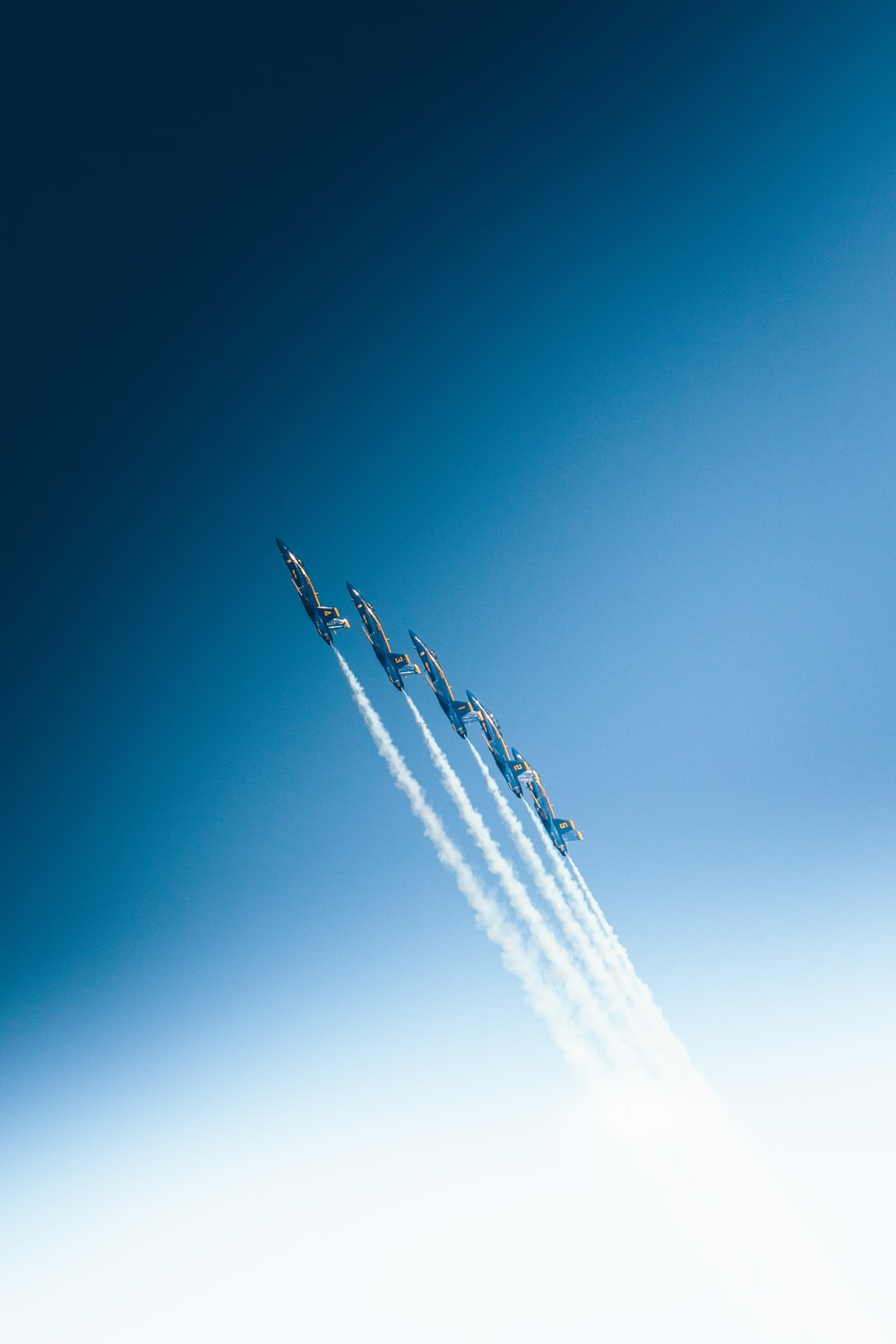 five jet flying in sky