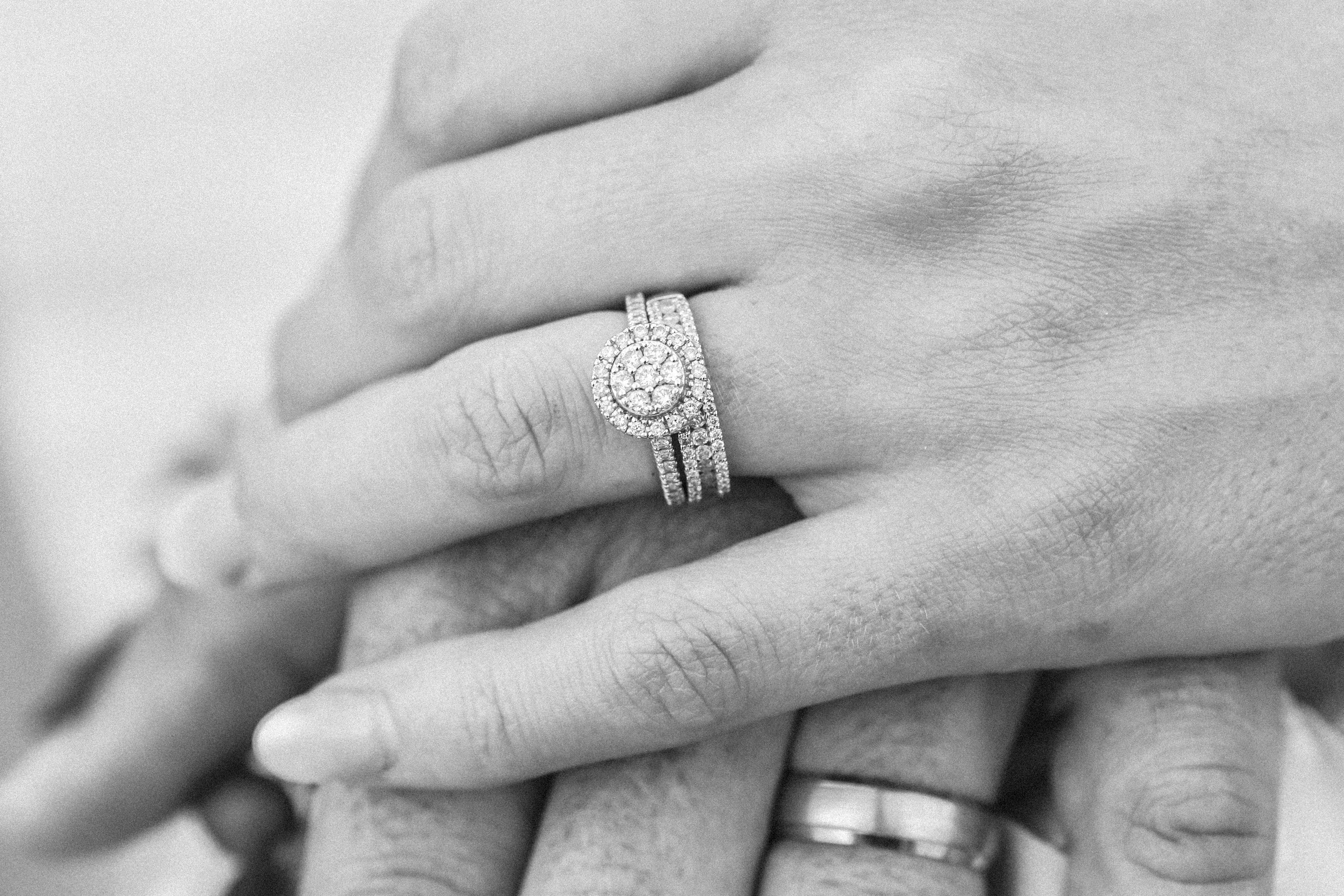 Hands Of A Married Couple Wearing Wedding Rings