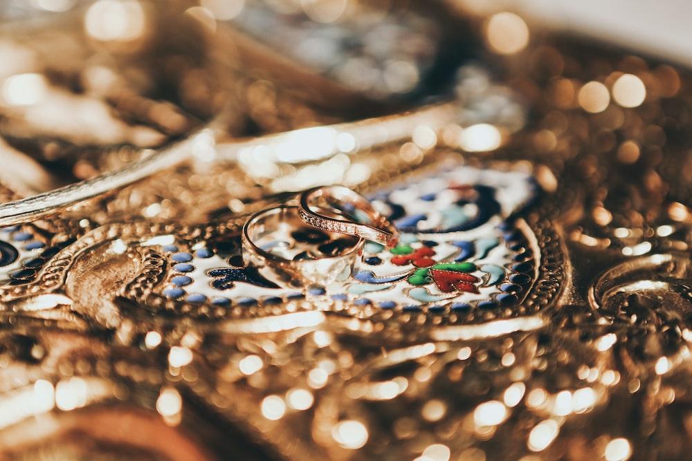 tilt shift lens photo of gold-colored rings