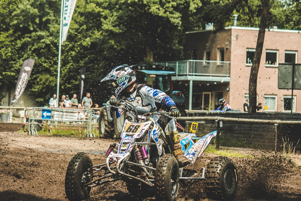 time lapse photography of man riding ATV
