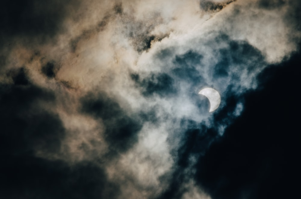 crescent moon covered with clouds at night