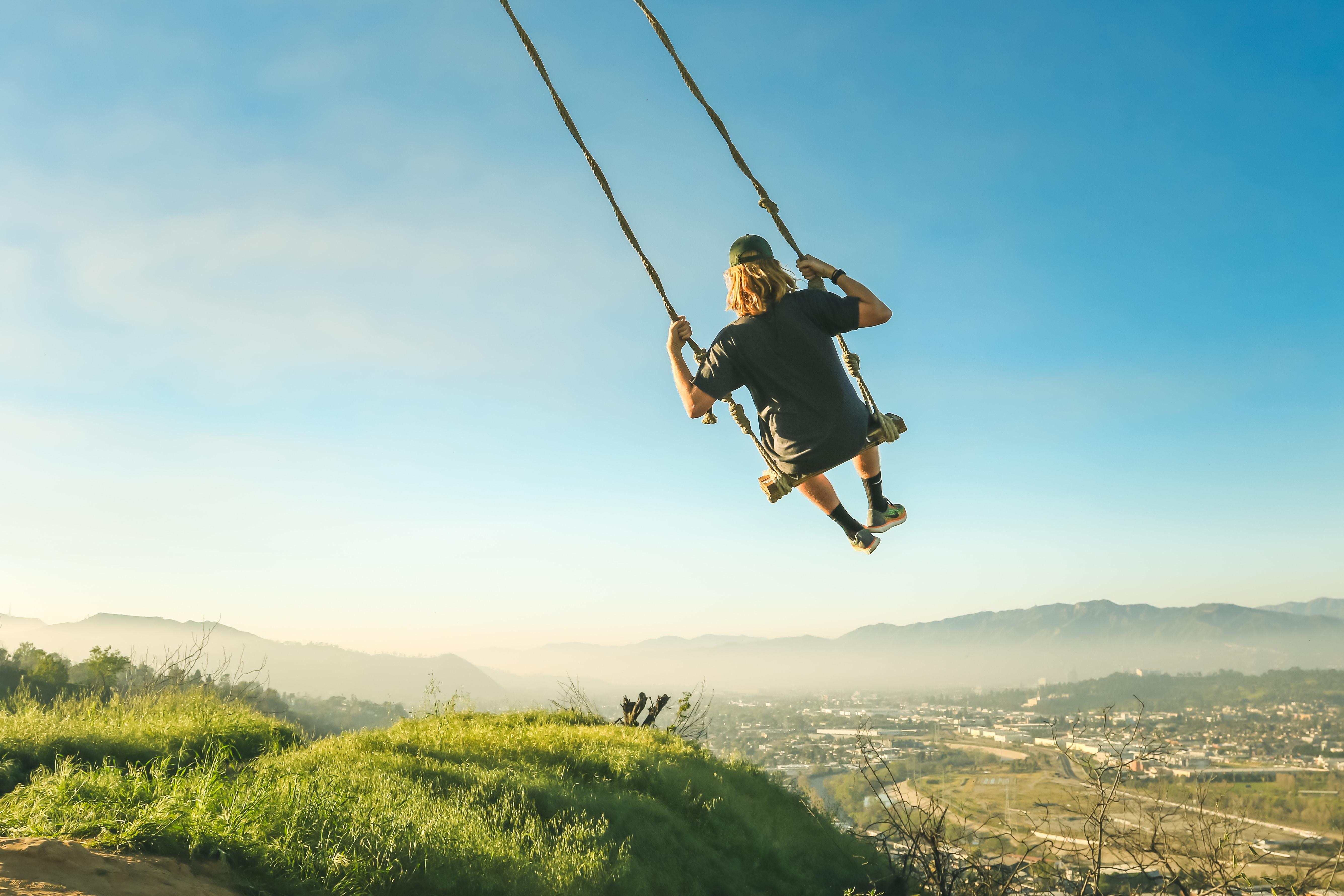 women riding swing