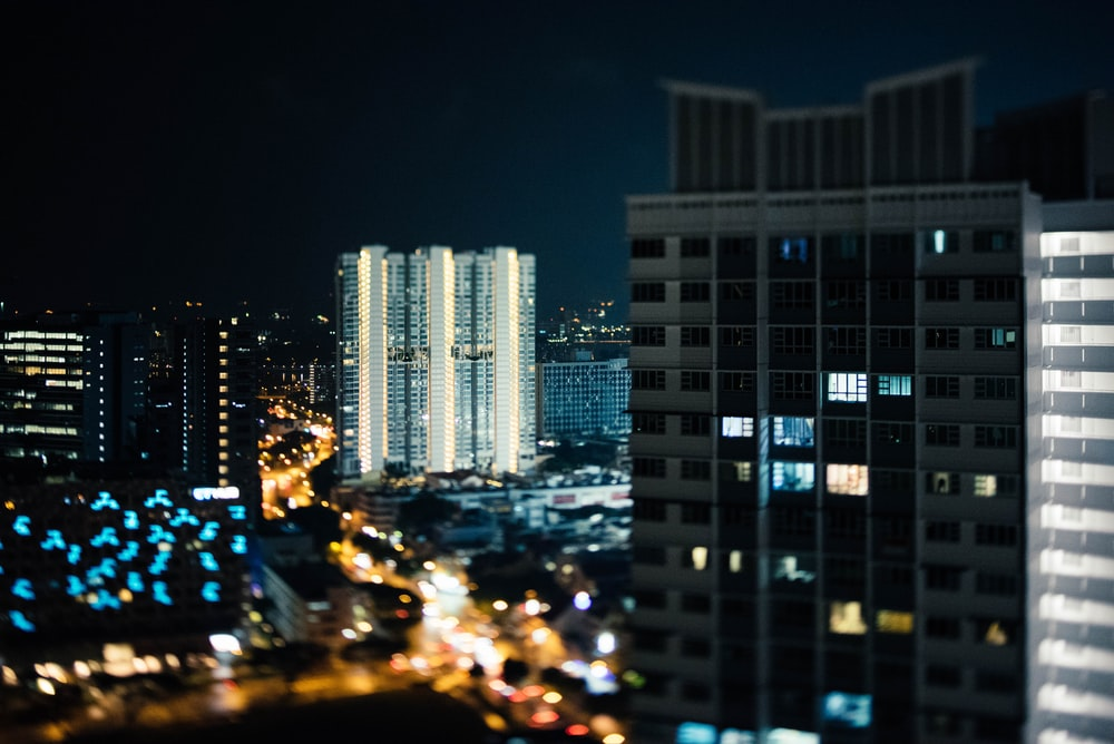 lighted high-rise buildings at night