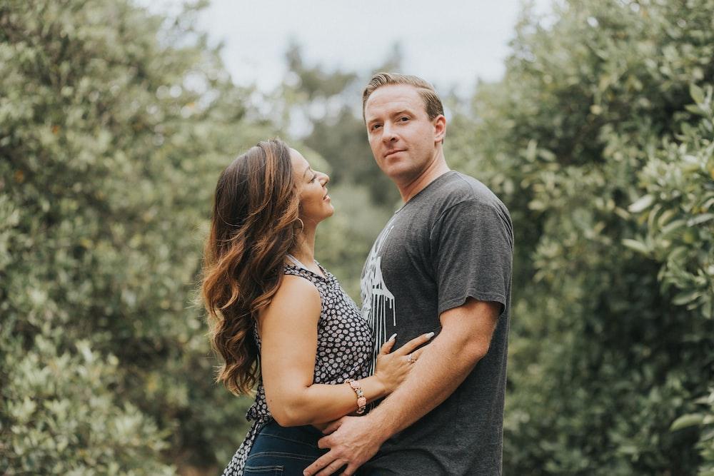 man and woman hugging during daytime