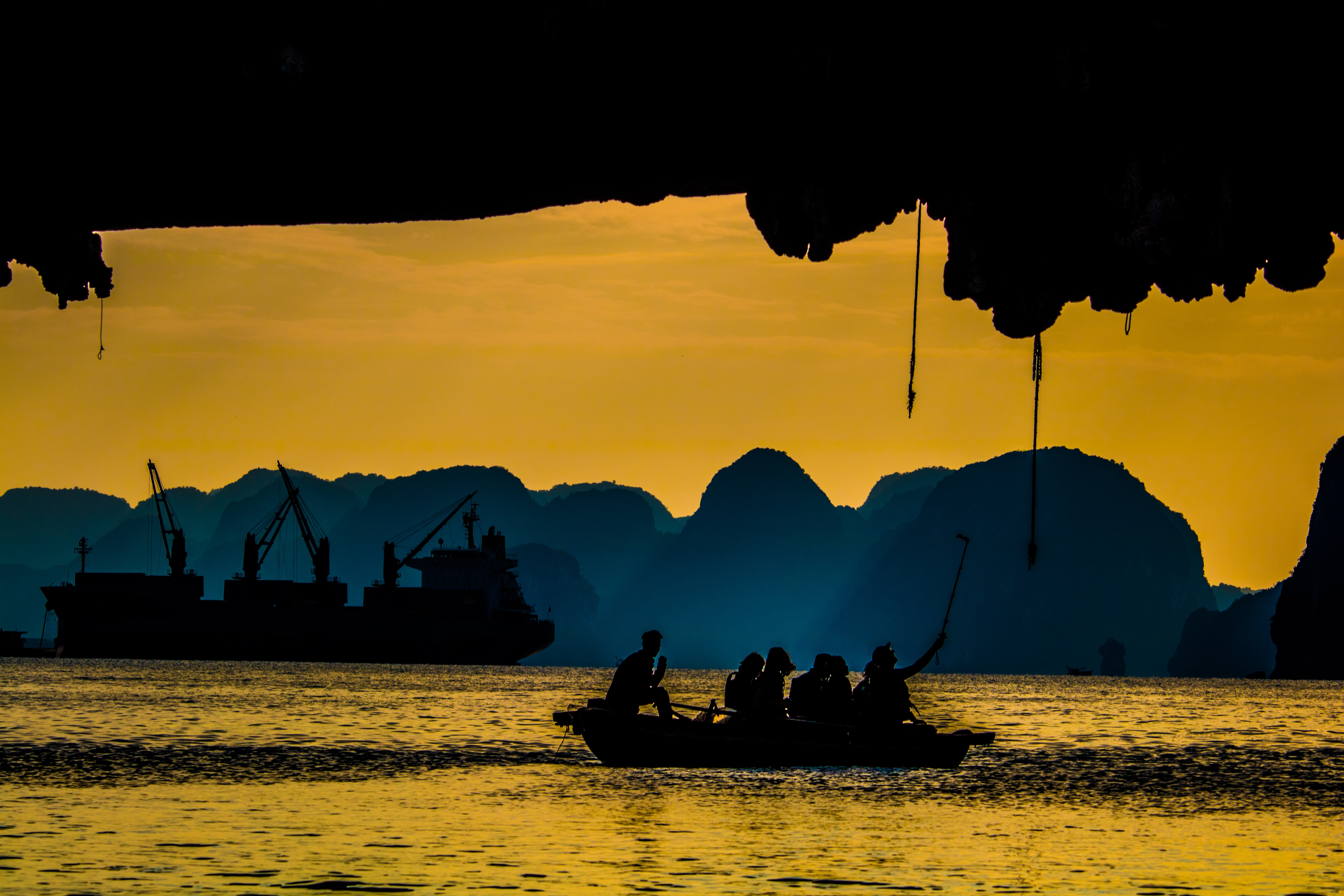 silhouette group of people riding on boat