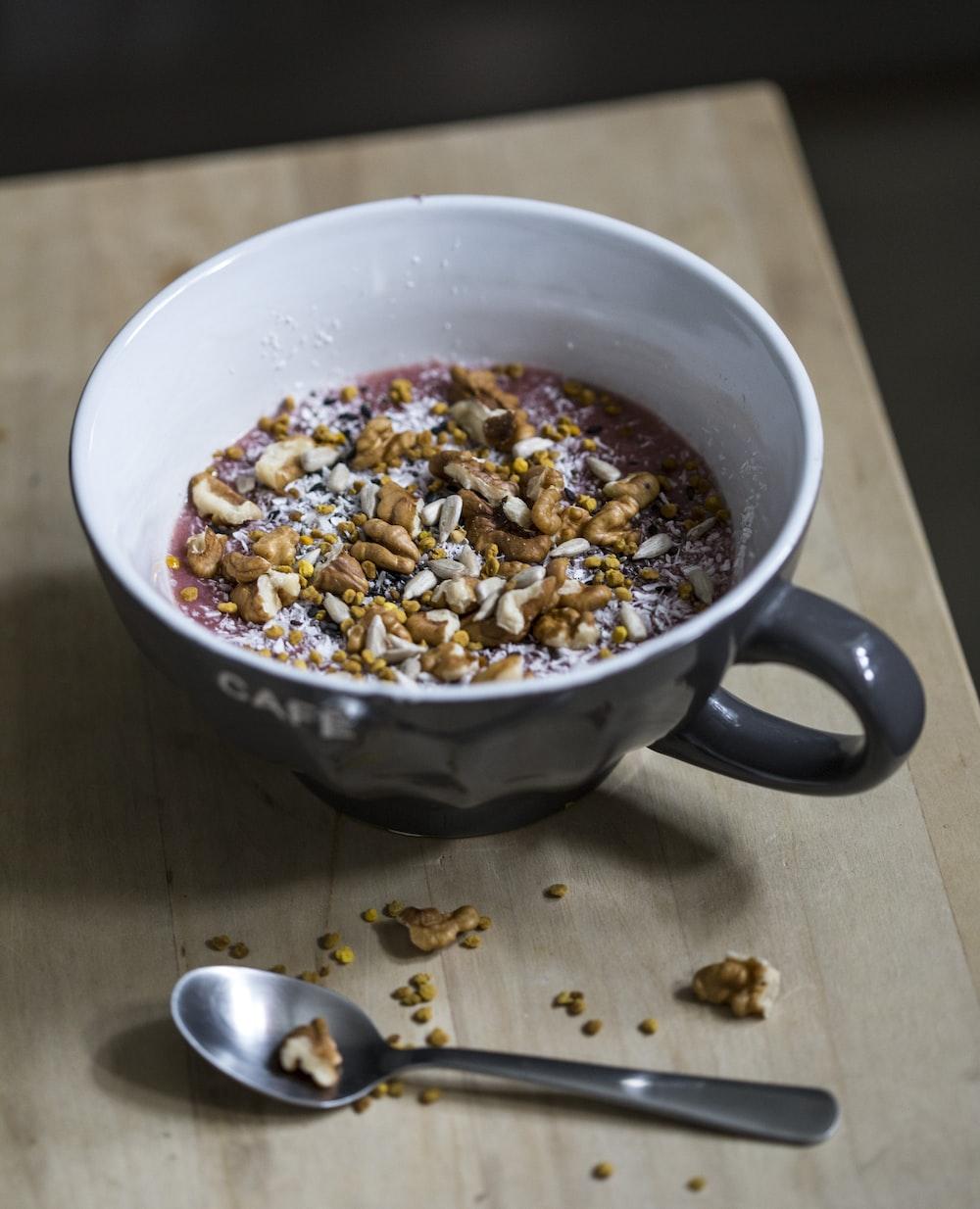 mug with cereal on table