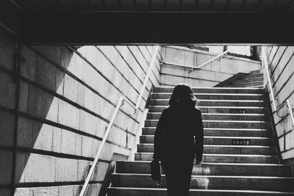 woman going upstairs
