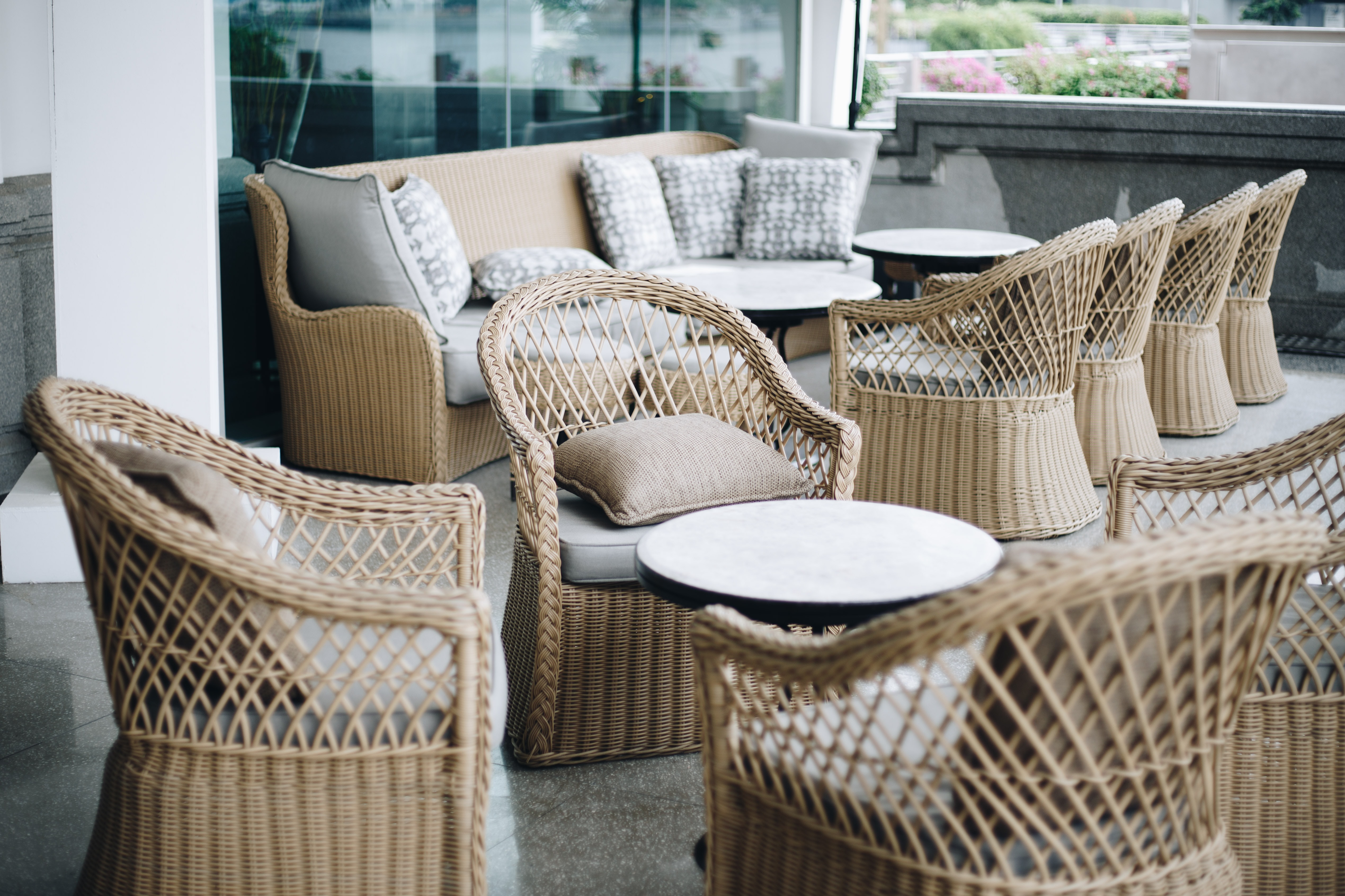 brown rattan chair lot outside the house