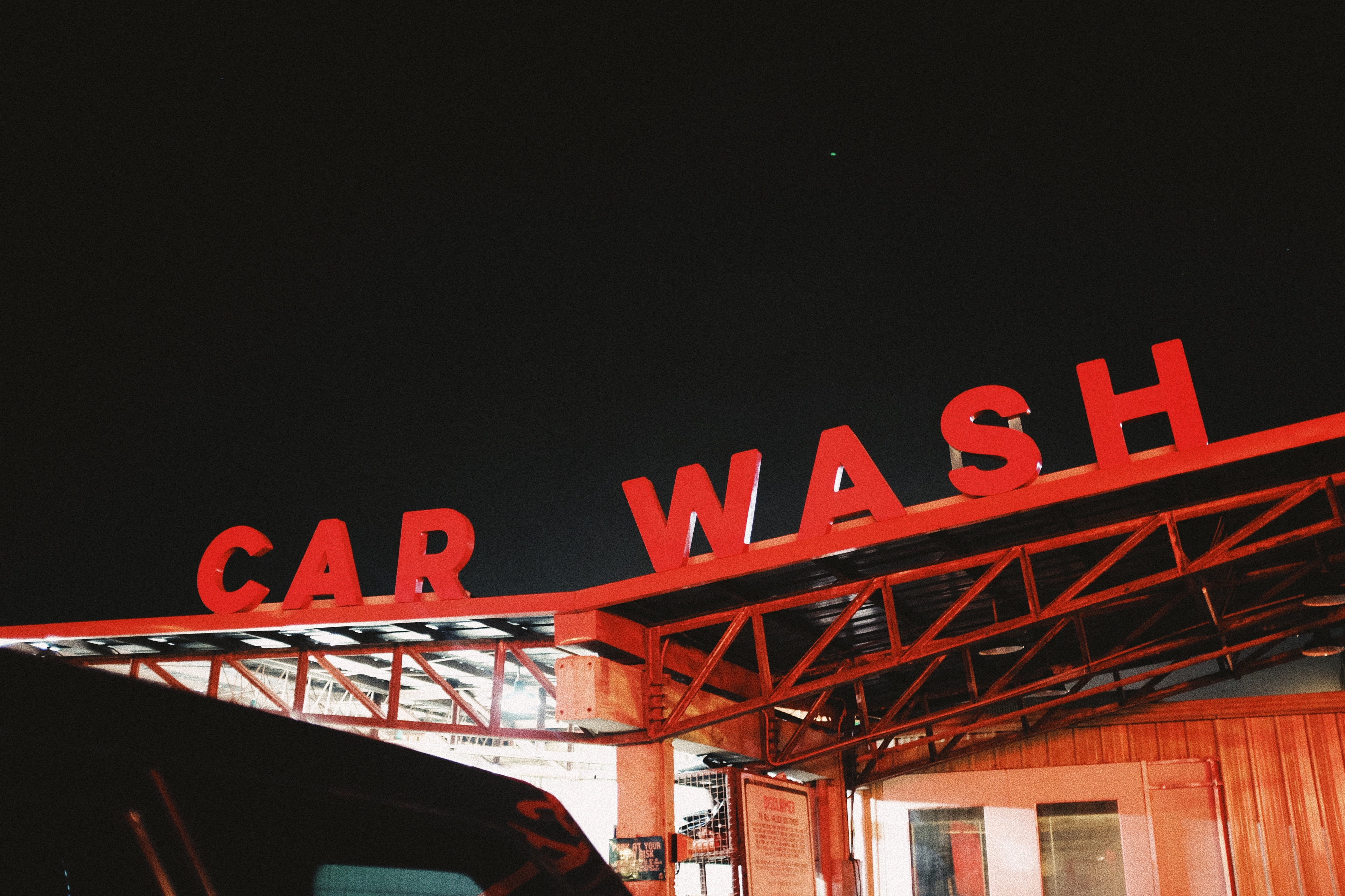 red Car Wash cutout signage on top of roof