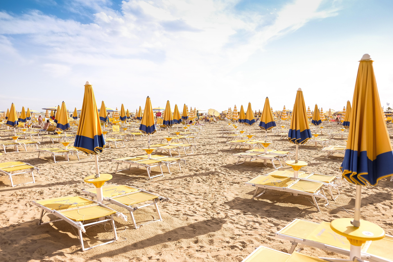 seashore with lounger and patio umbrella