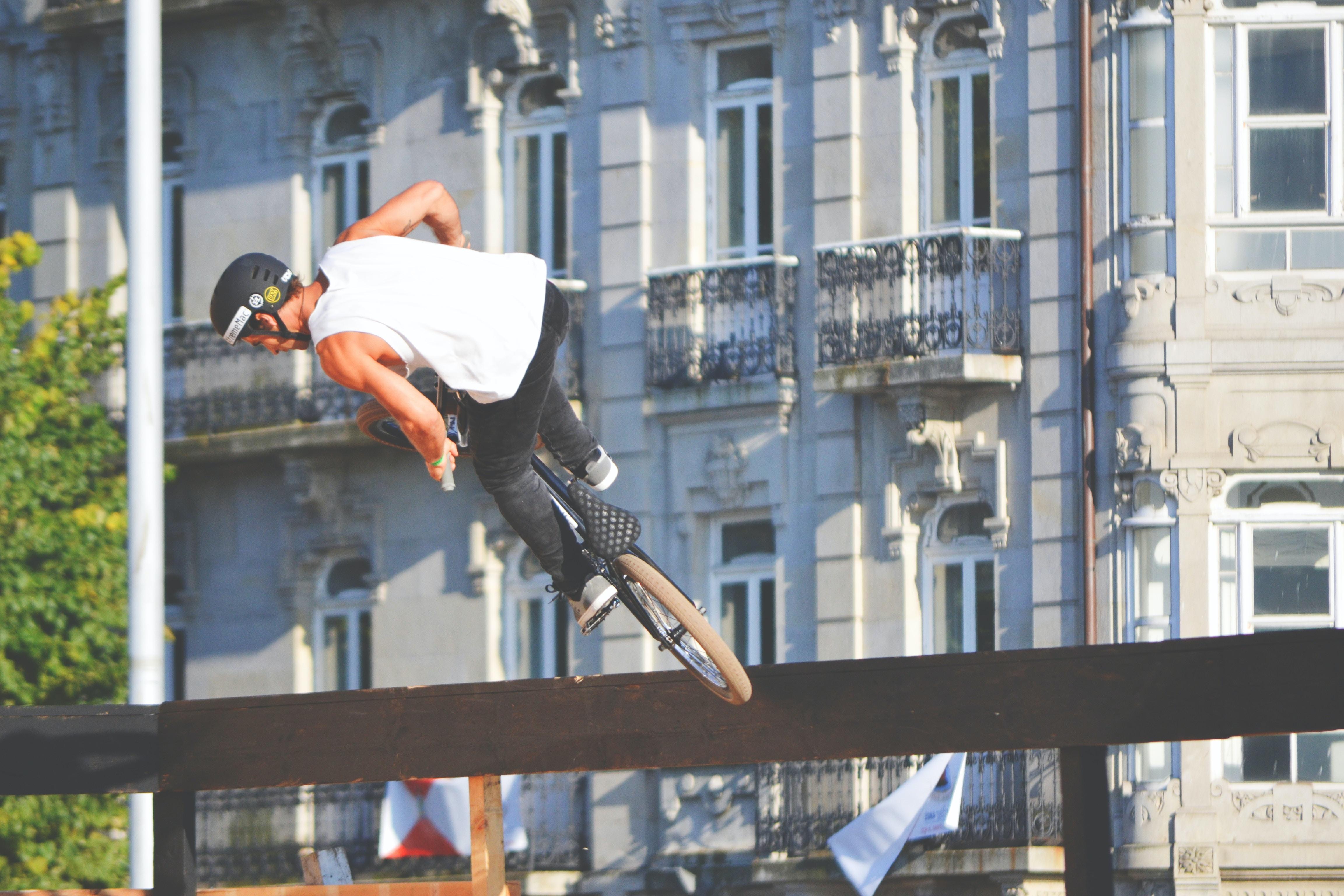 man riding bike doing stunt