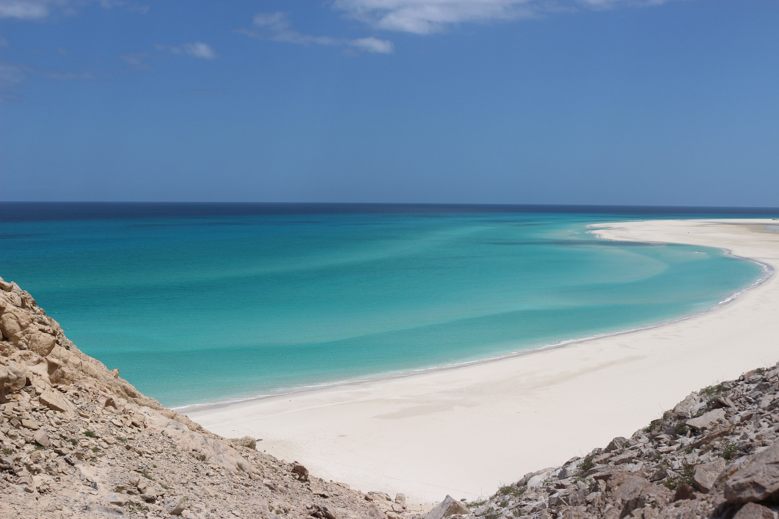 landscape photo of seashore under blue sky