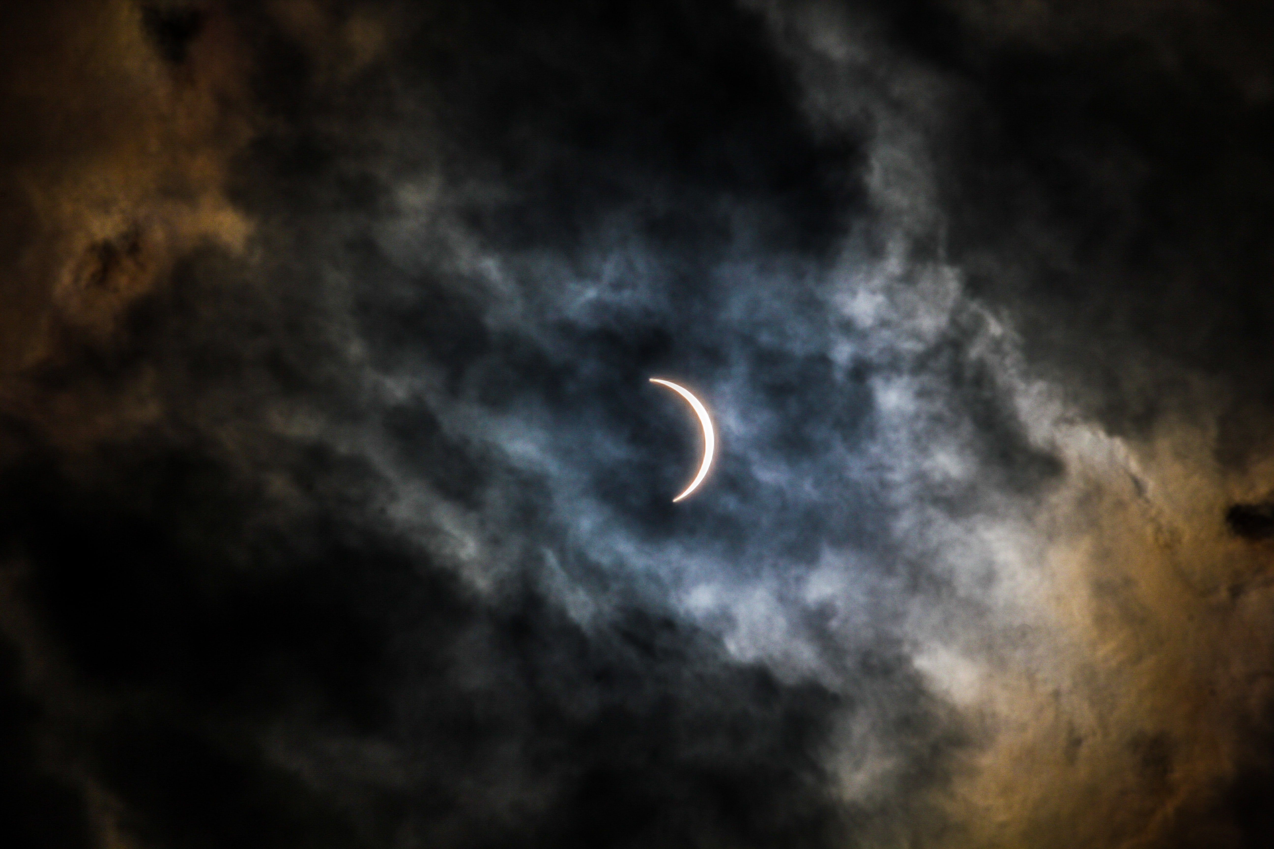crescent moon covered with clouds
