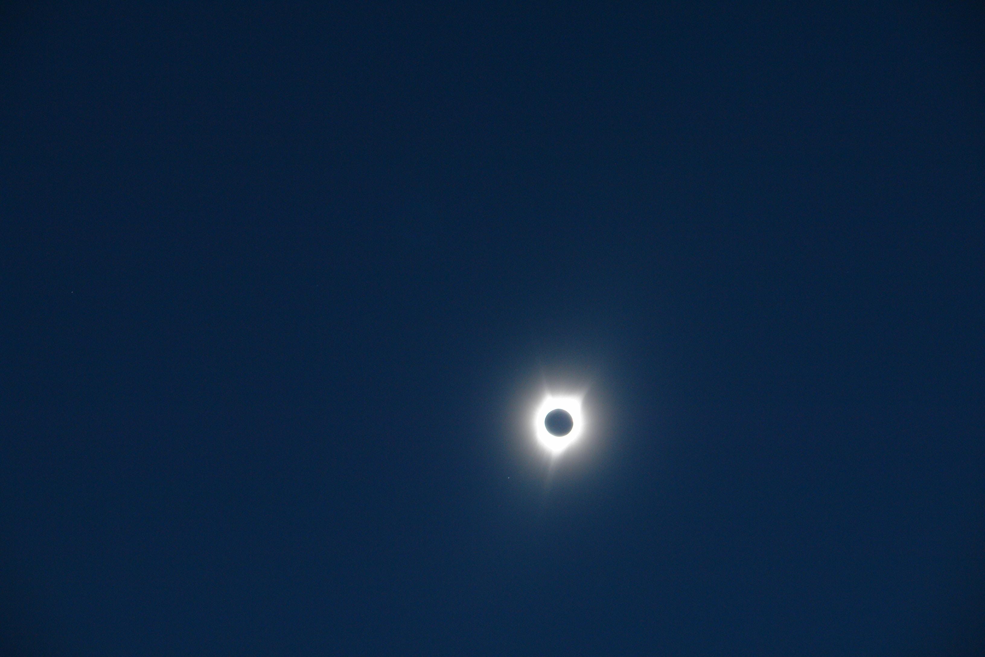 A solar eclipse creating a dark blue sky.