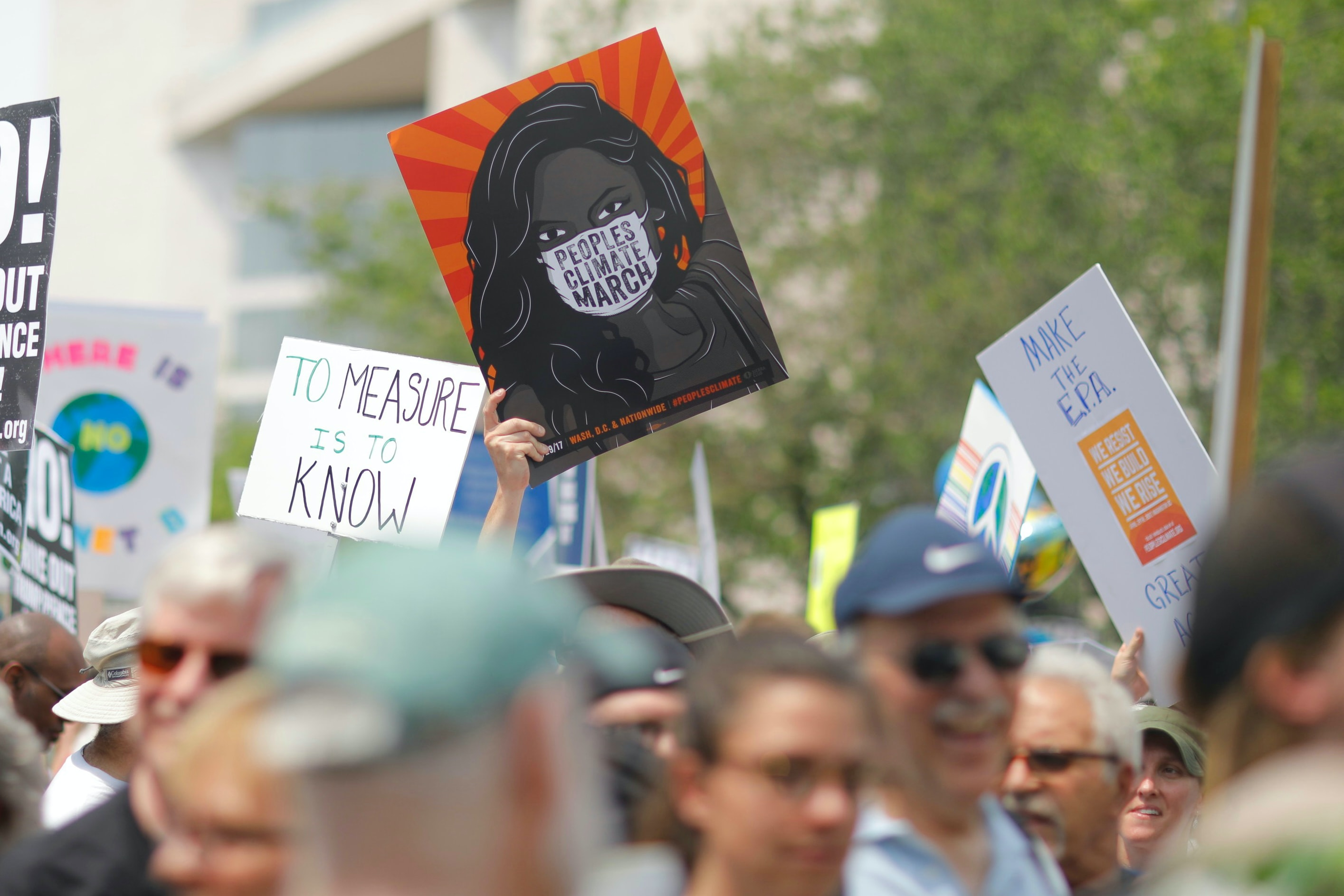 Protesters are holding various signs with different messages during the Peoples Climate March in Washington.