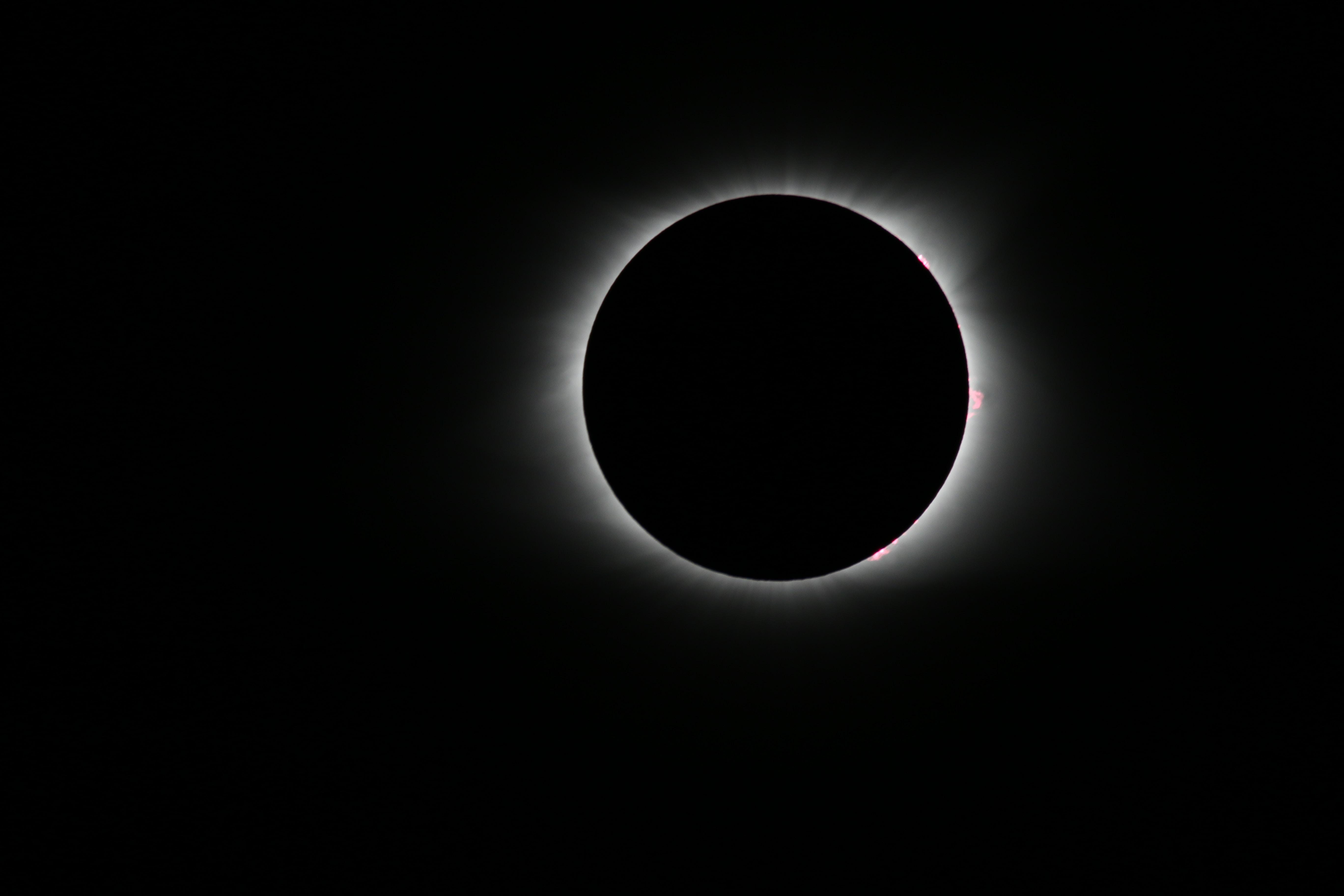 A lunar eclipse at night.