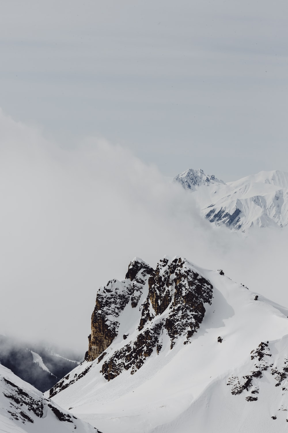 mountains covering snow during daytime