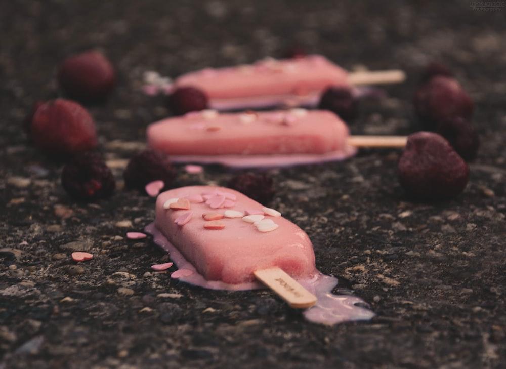 three pink ice creams