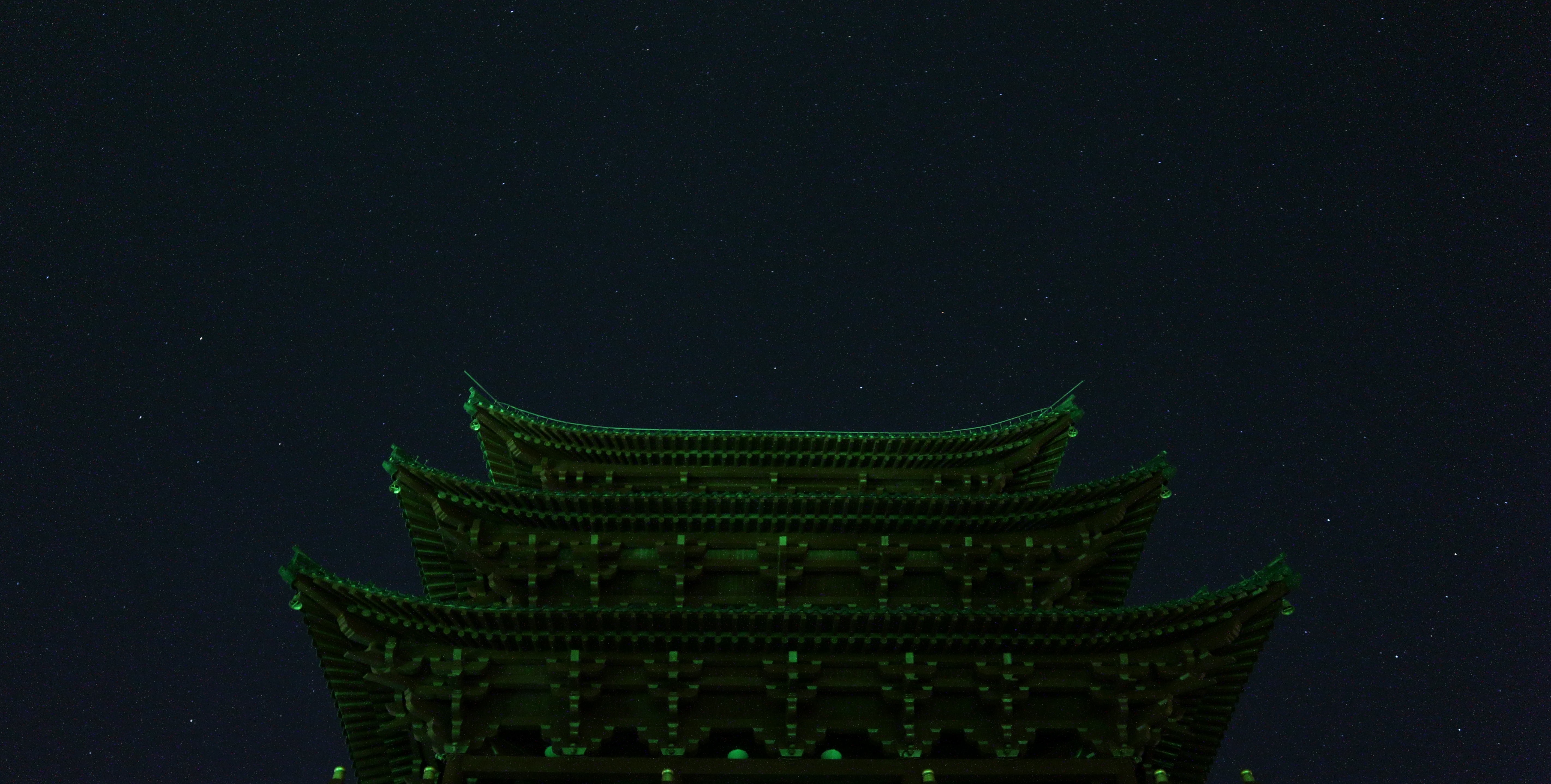 A building illuminated with green lights.