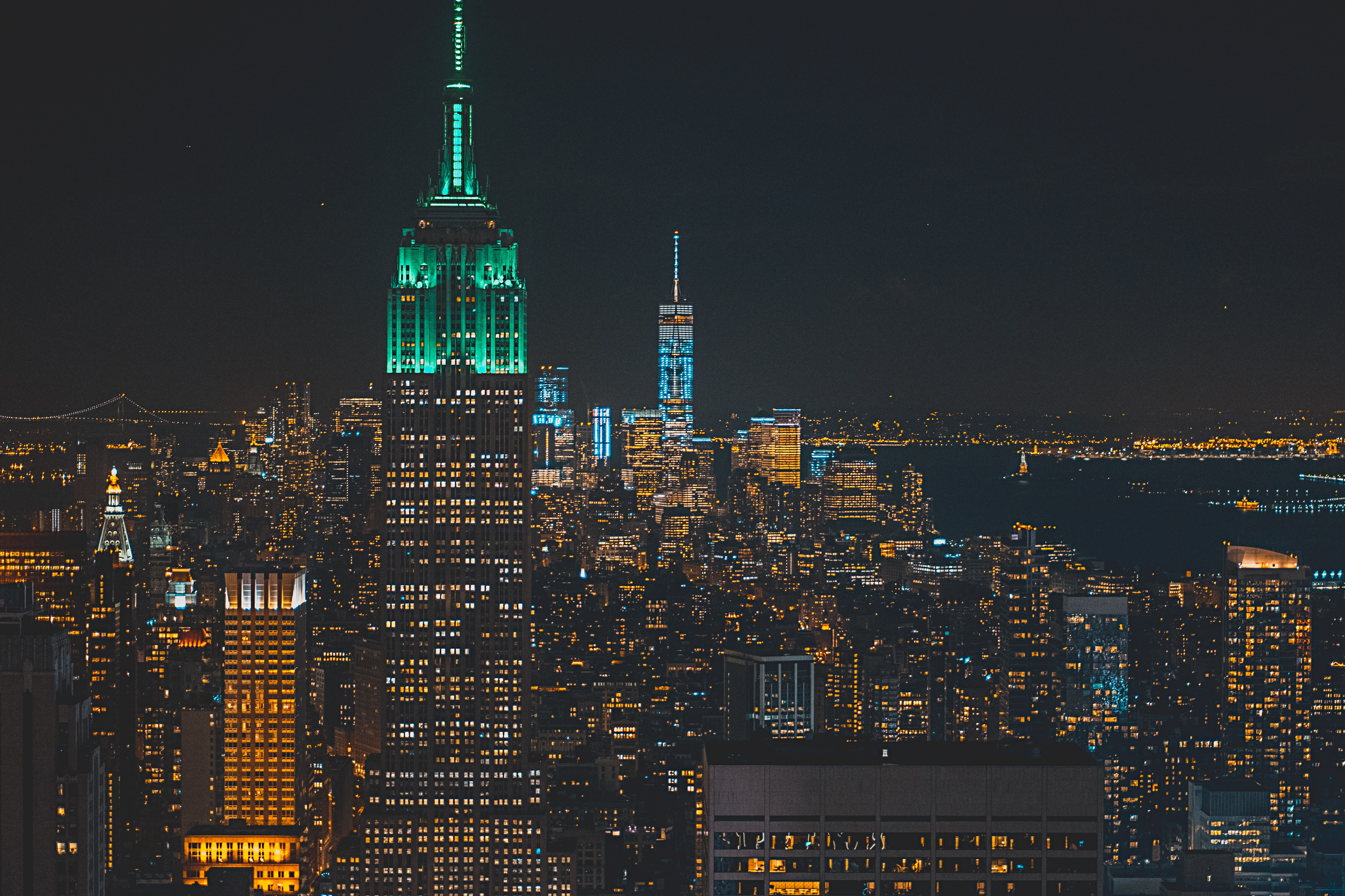 View of the Empire State Building with a NYC skyline lit up at night