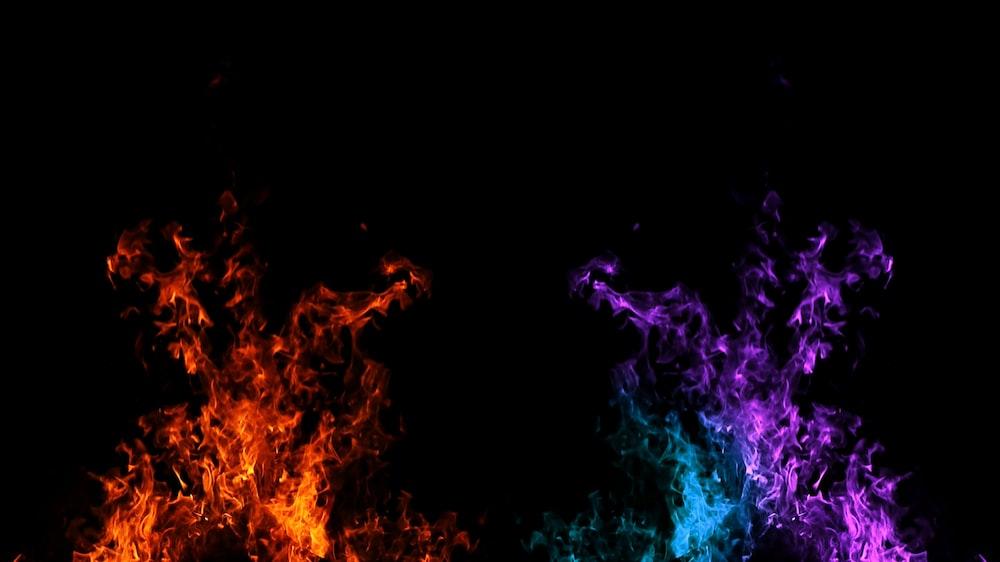 orange, blue, and purple smoke bombs
