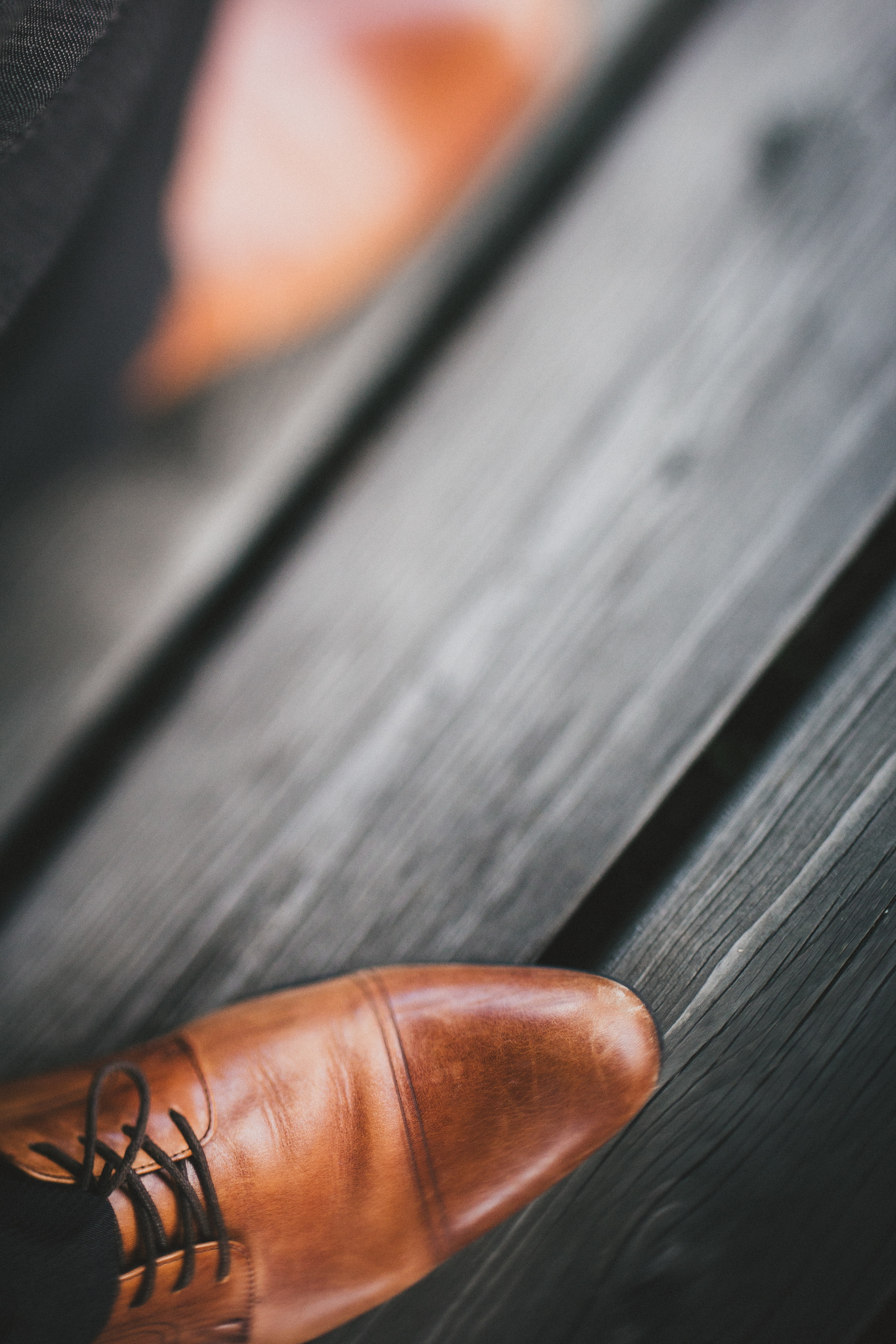 selective photography of brown leather dress shoe