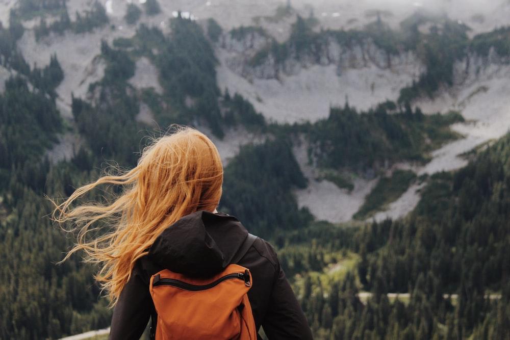woman seeing mountain during daytime