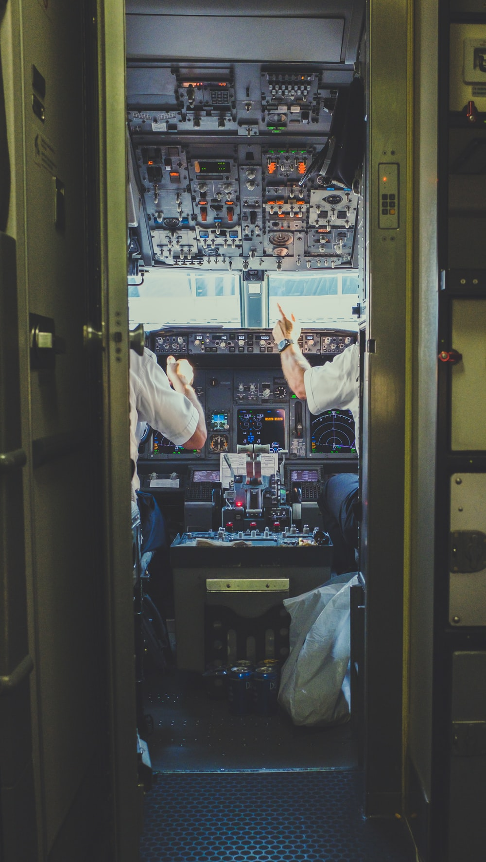 pilot and copilot inside plane cockpit