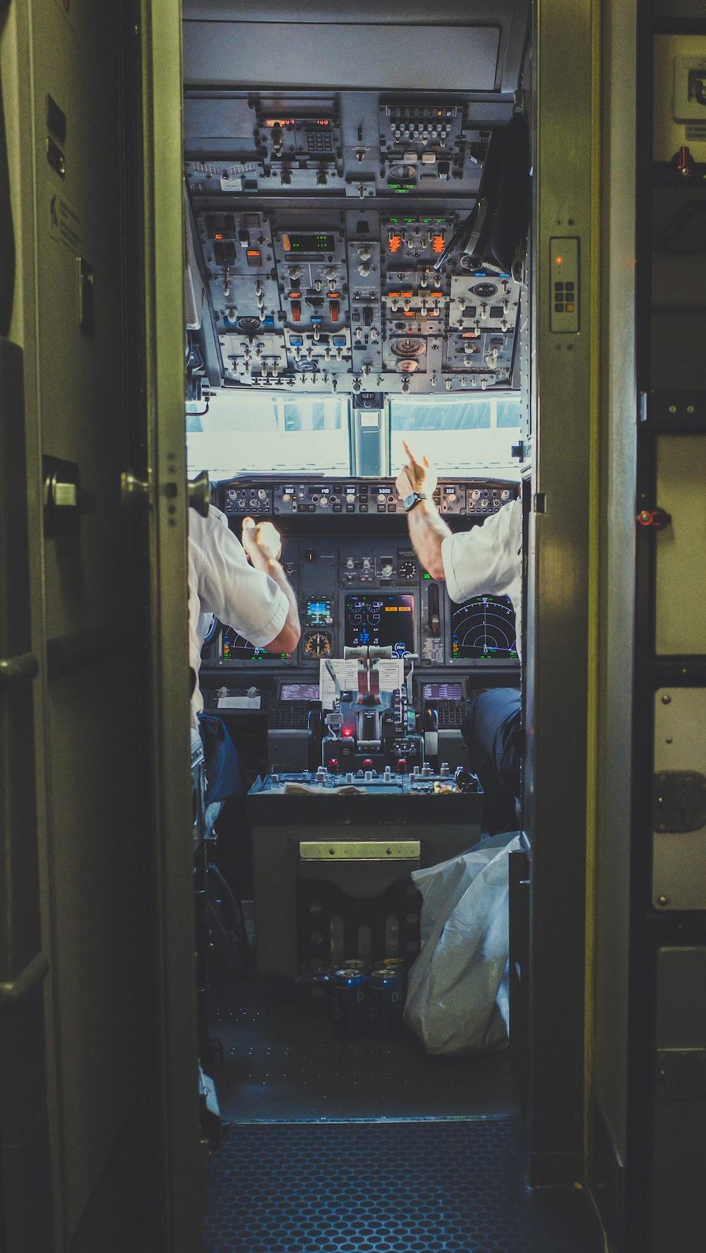 pilot and copilot inside plane cockpit