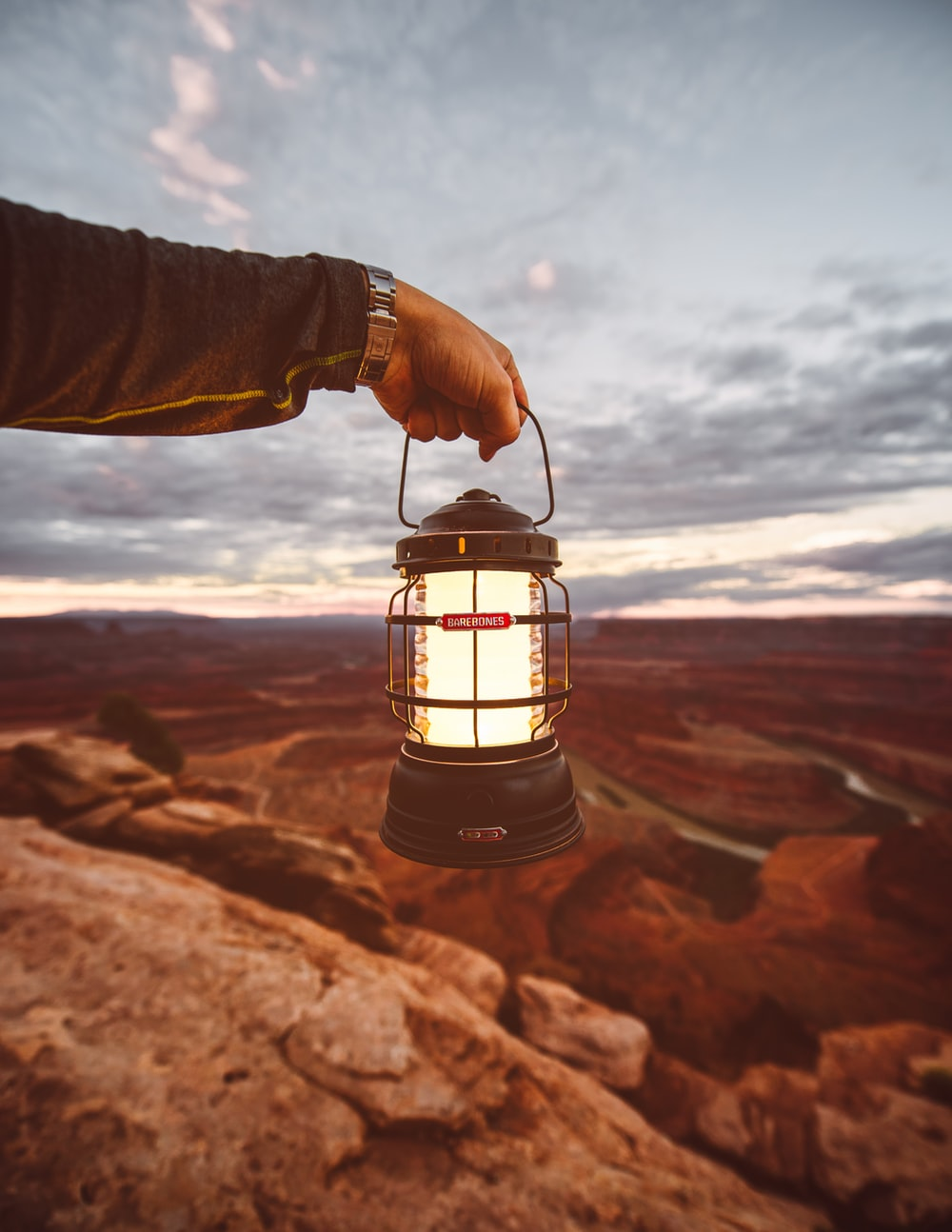 person holding camping lantern