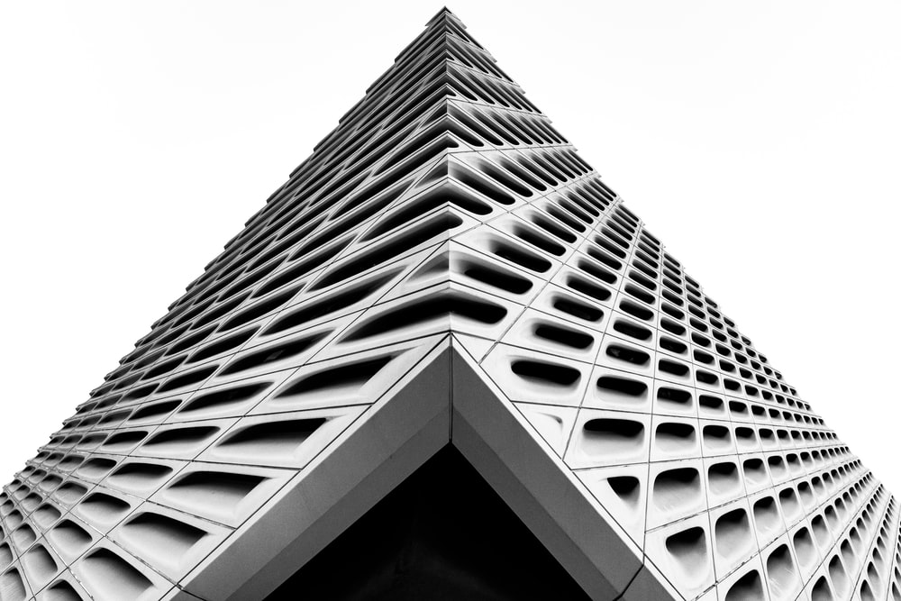 low angle photography of buildings corner
