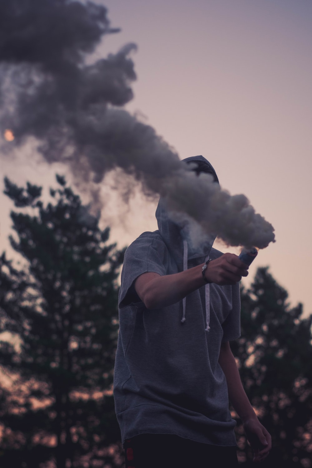 Person Holding Smoke Bomb Pictures Download Free Images On