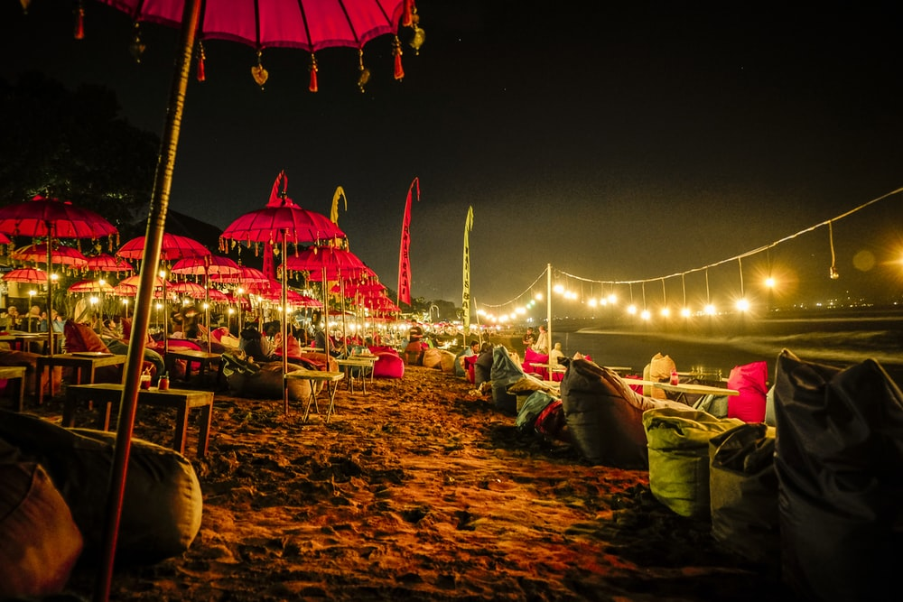 red umbrellas and yellow lights on shore