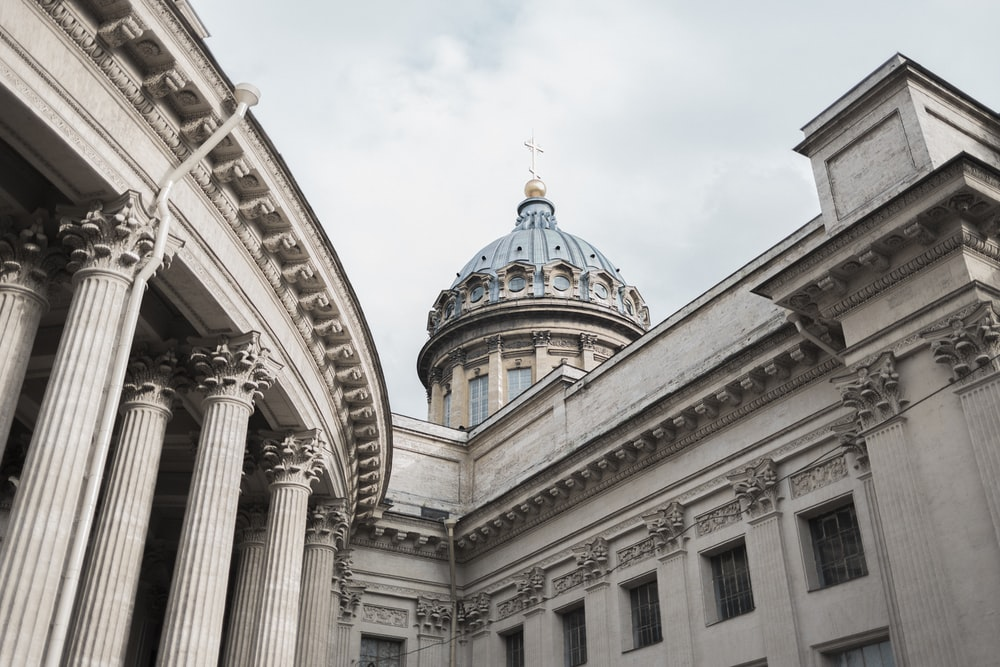 low-angle photography of gray and white dome concrete building