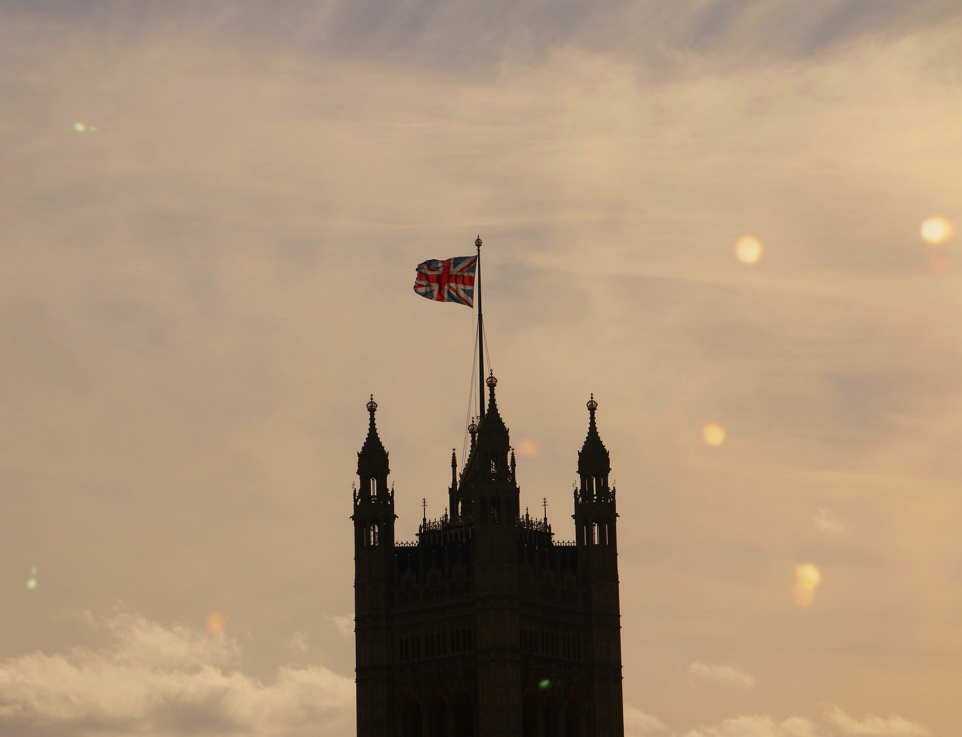 silhouette of 3-tower building with flag of U.K.