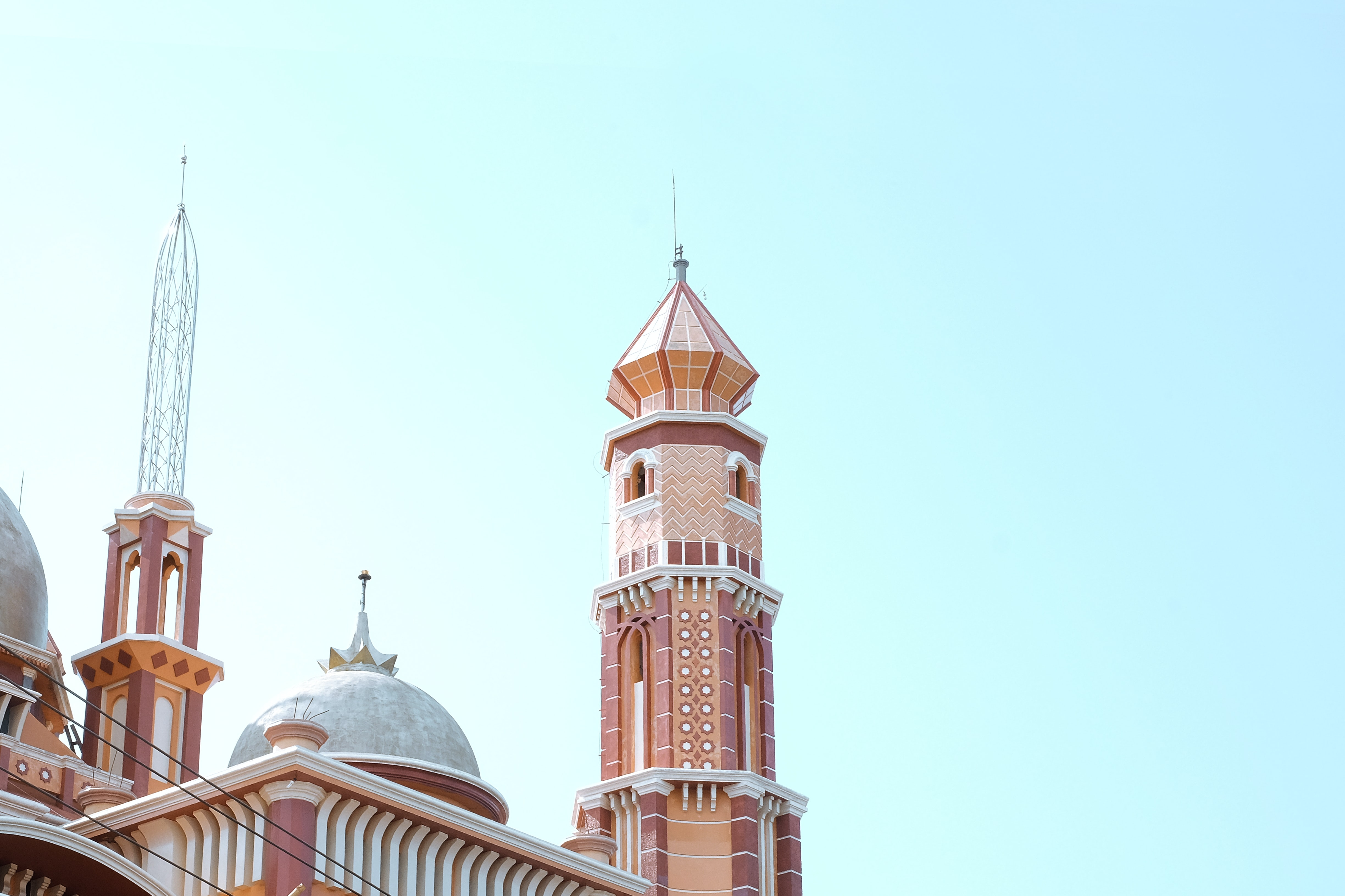 brown and white mosque building