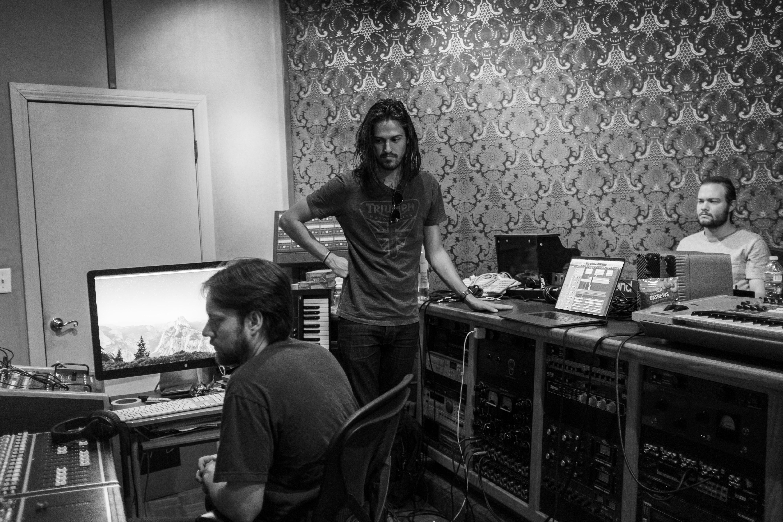 grayscale photograph of three men making music