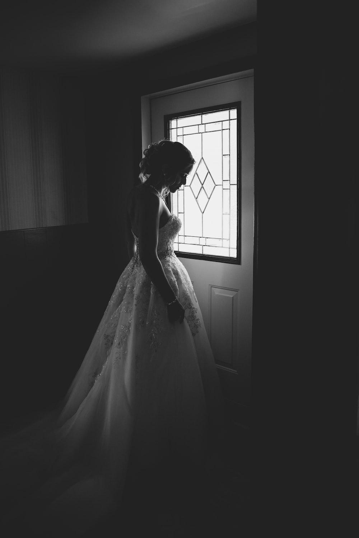 woman standing behind the door