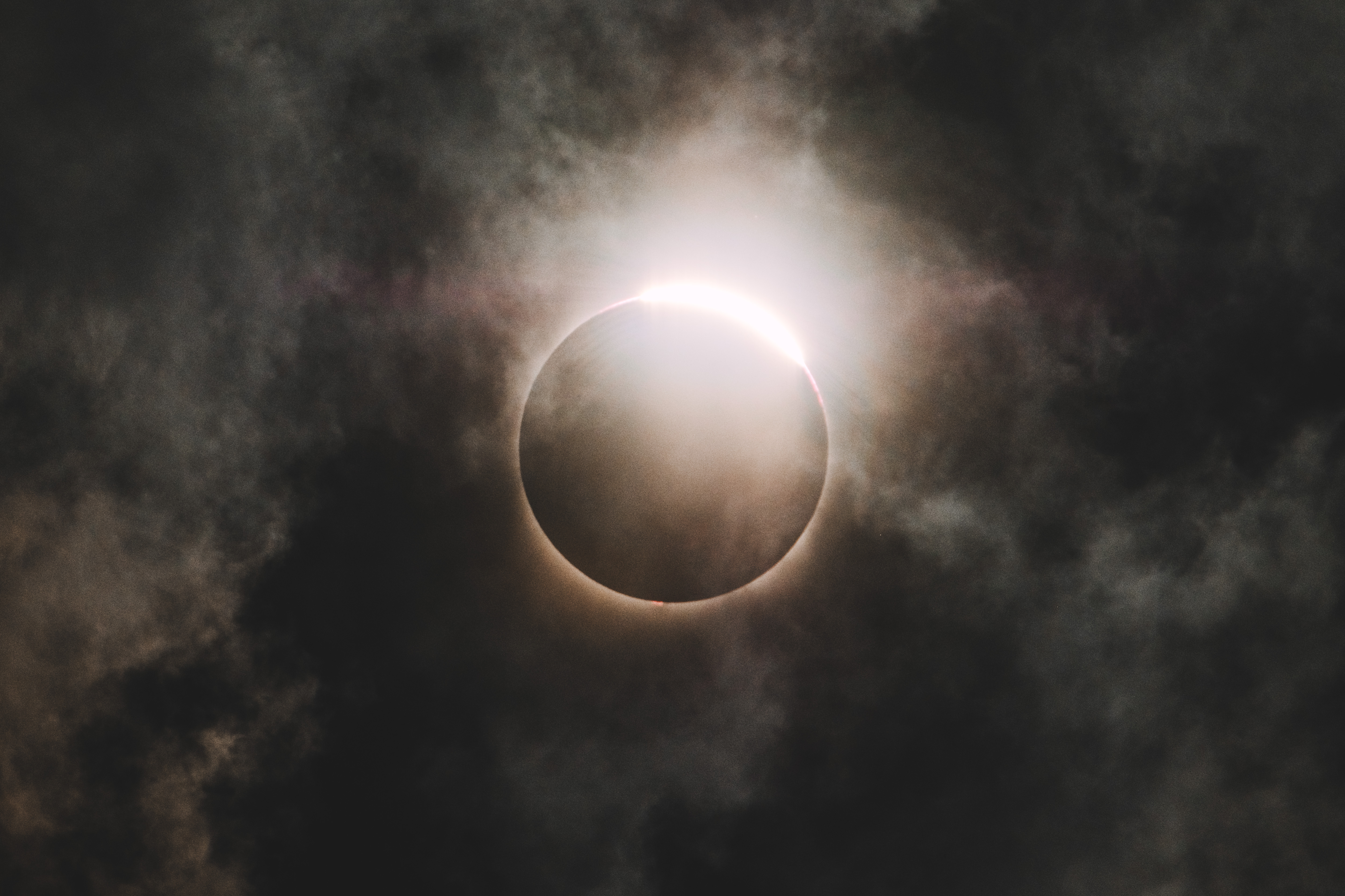 a solar eclipse darkening the sky as clouds passed by it cool backgrounds p81 cool