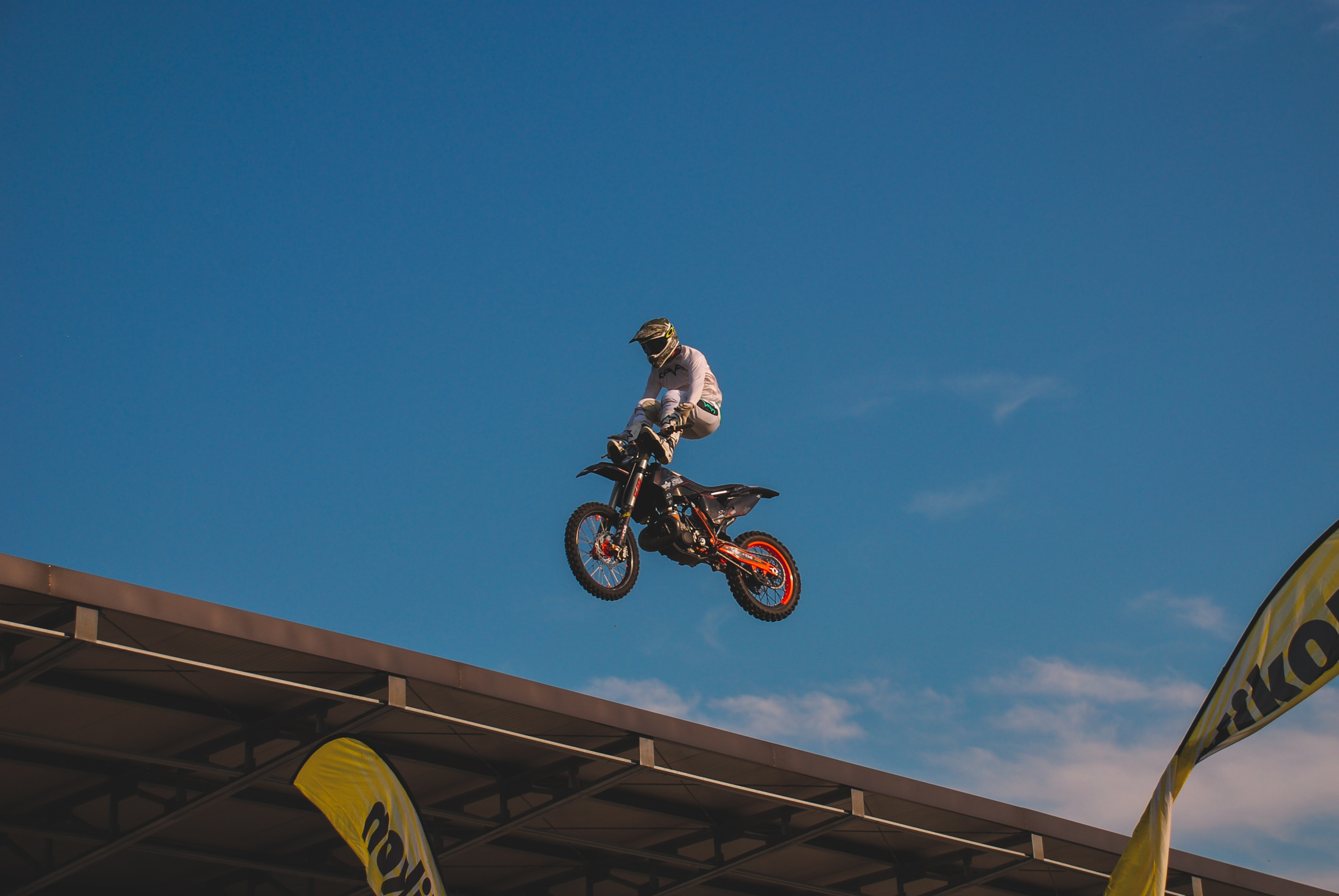 man on dirt bike on roof