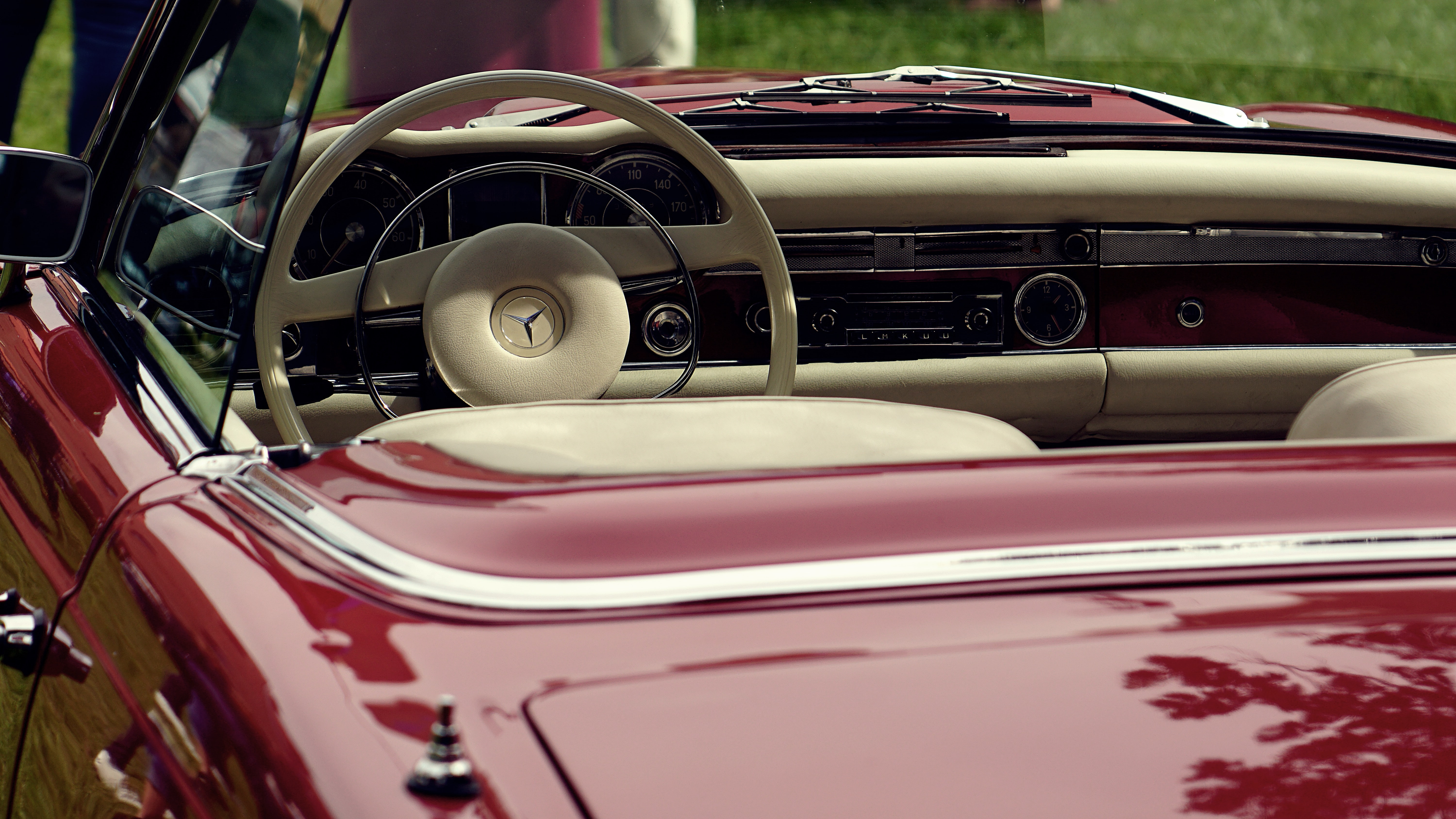 red Mercedes-Benz convertible coupe