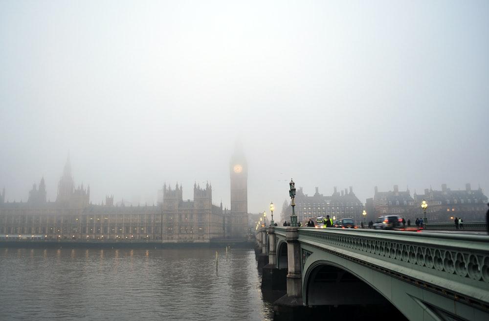 gray bridge towards Big Ben under gray sky