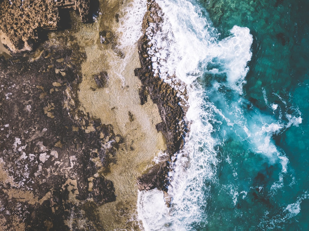 aerial photo of beach with stones