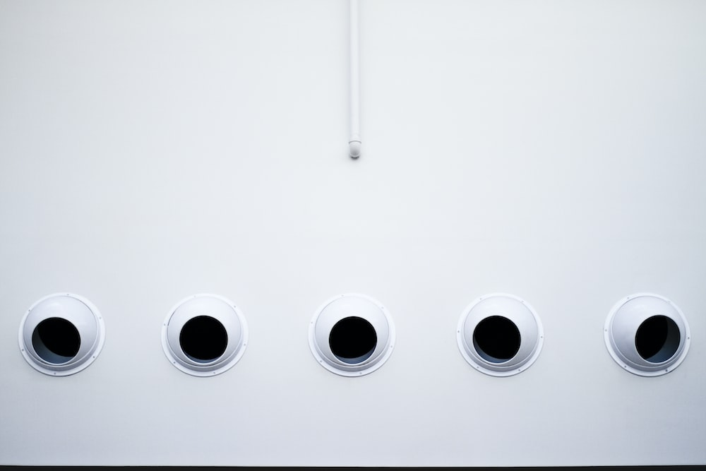 five white security camera on wall