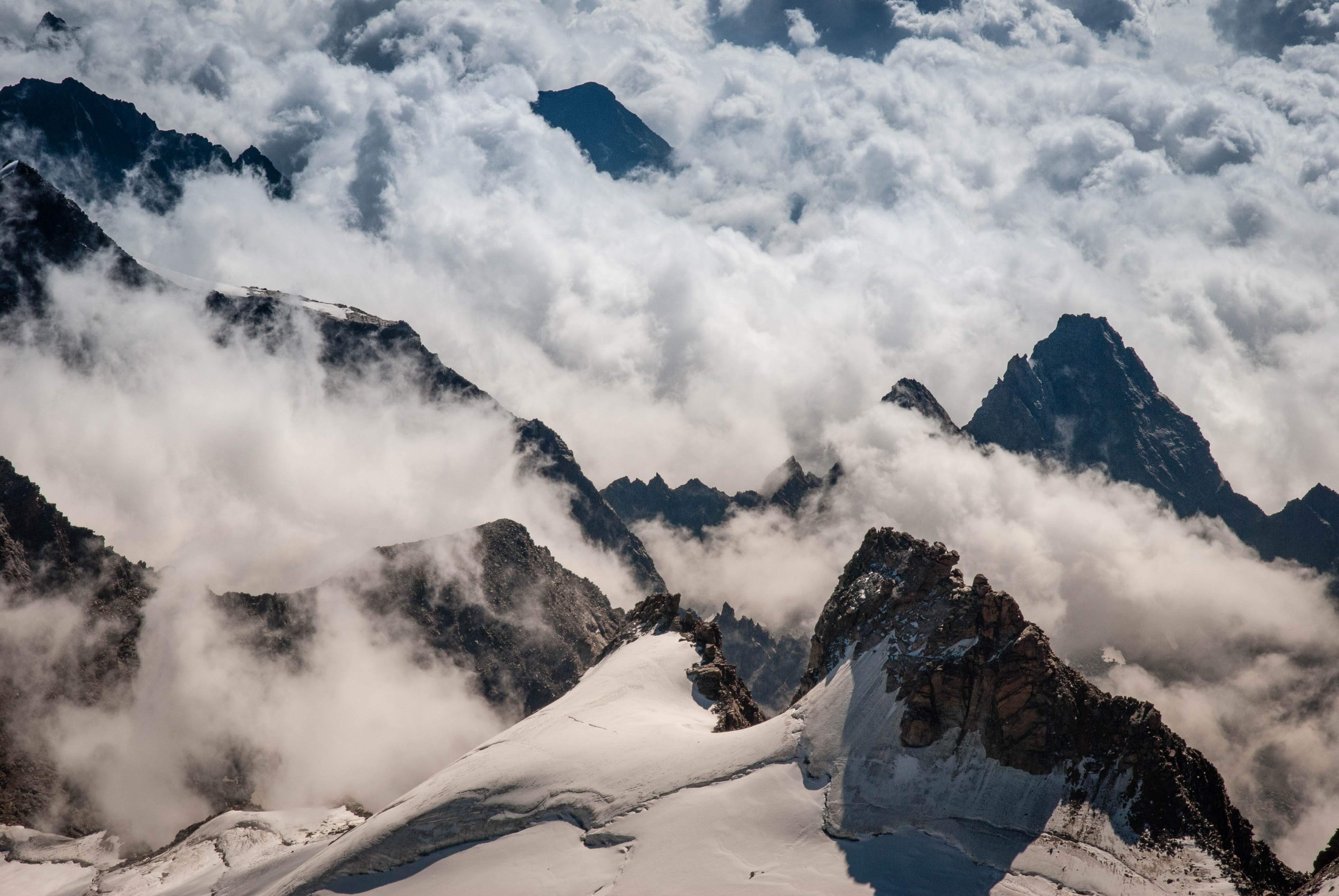 aerial view of mountains covered with clouds