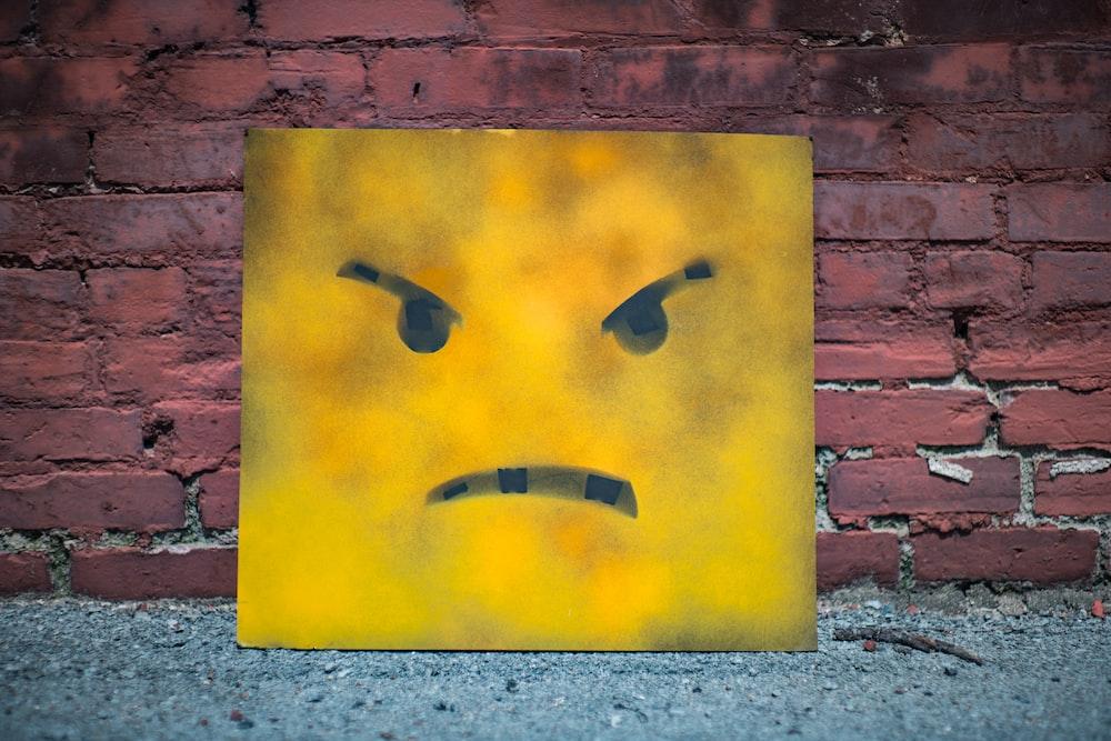 yellow and black smiley wall art