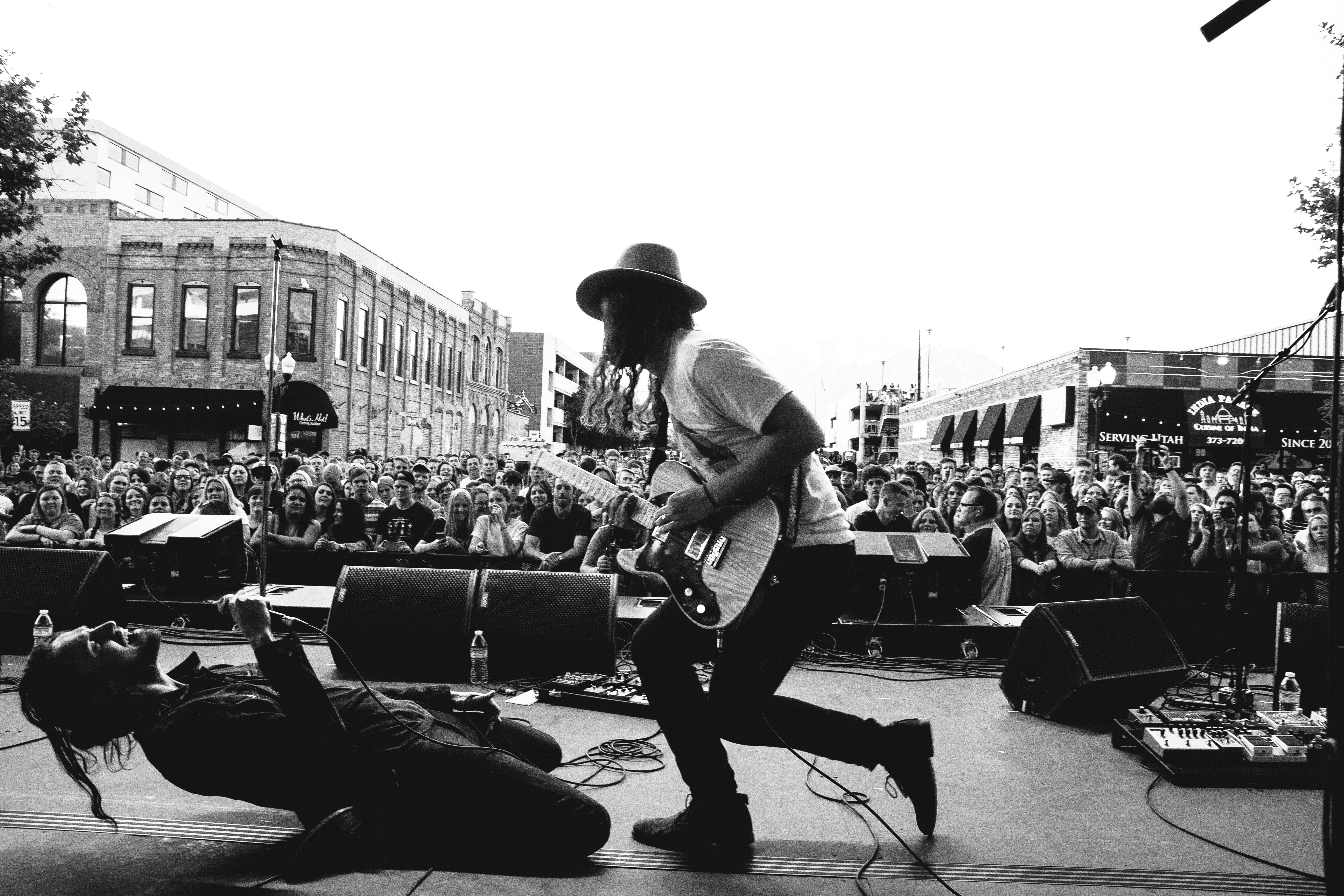 grayscale photography of concert during daytime