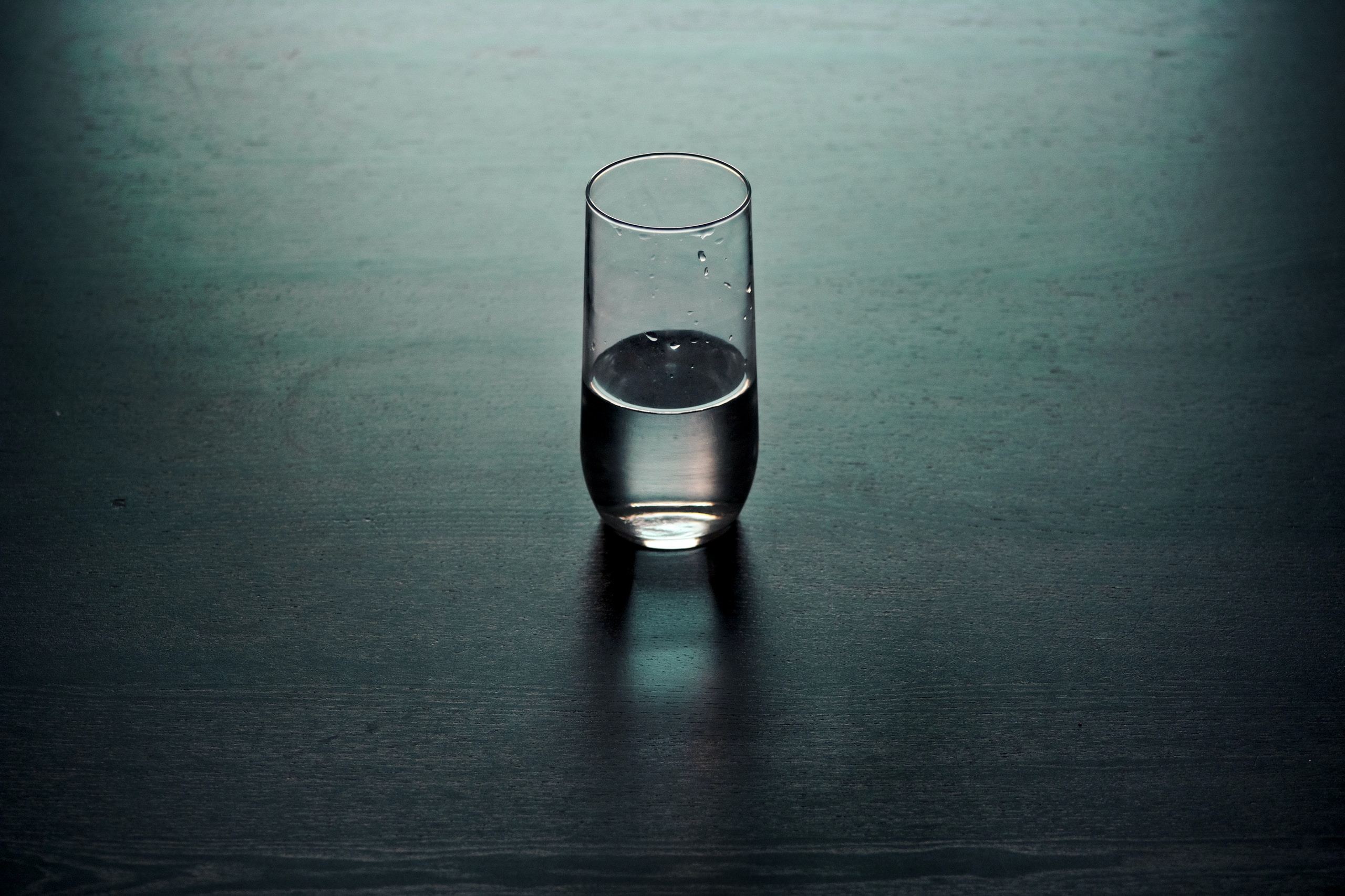 clear drinking glass on brown wooden surface
